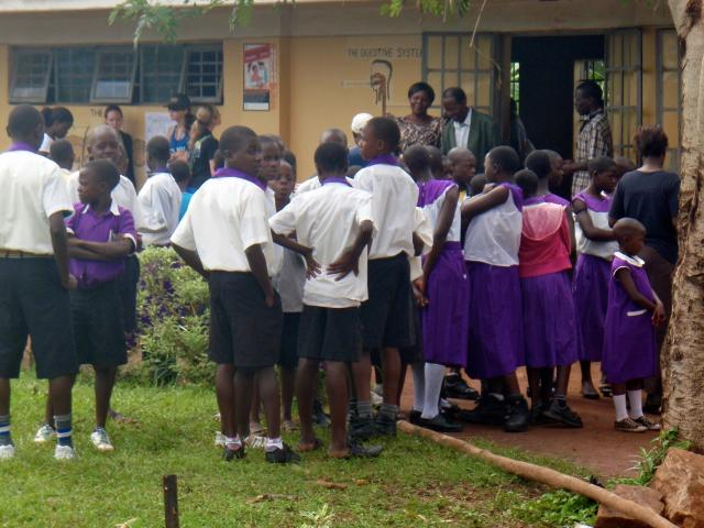 School children in Kasawo looking at medical clinic designs
