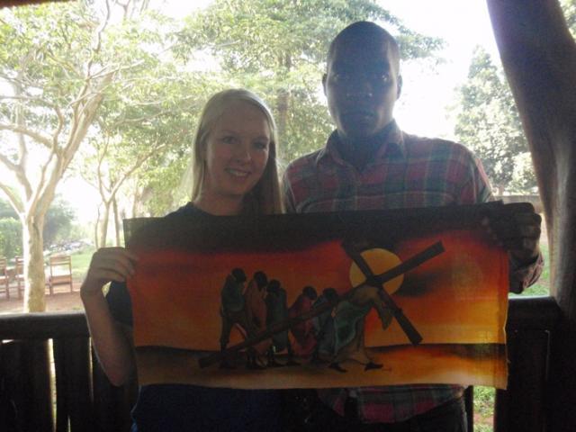 Godfrey Kalungi with artwork (& Emily Raecker)