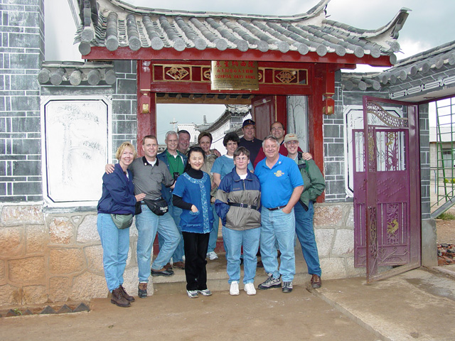 Group in front of Naxi home at LiJiang Orphanage