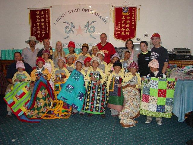 Group quilts and hats at Tibetan orphanage