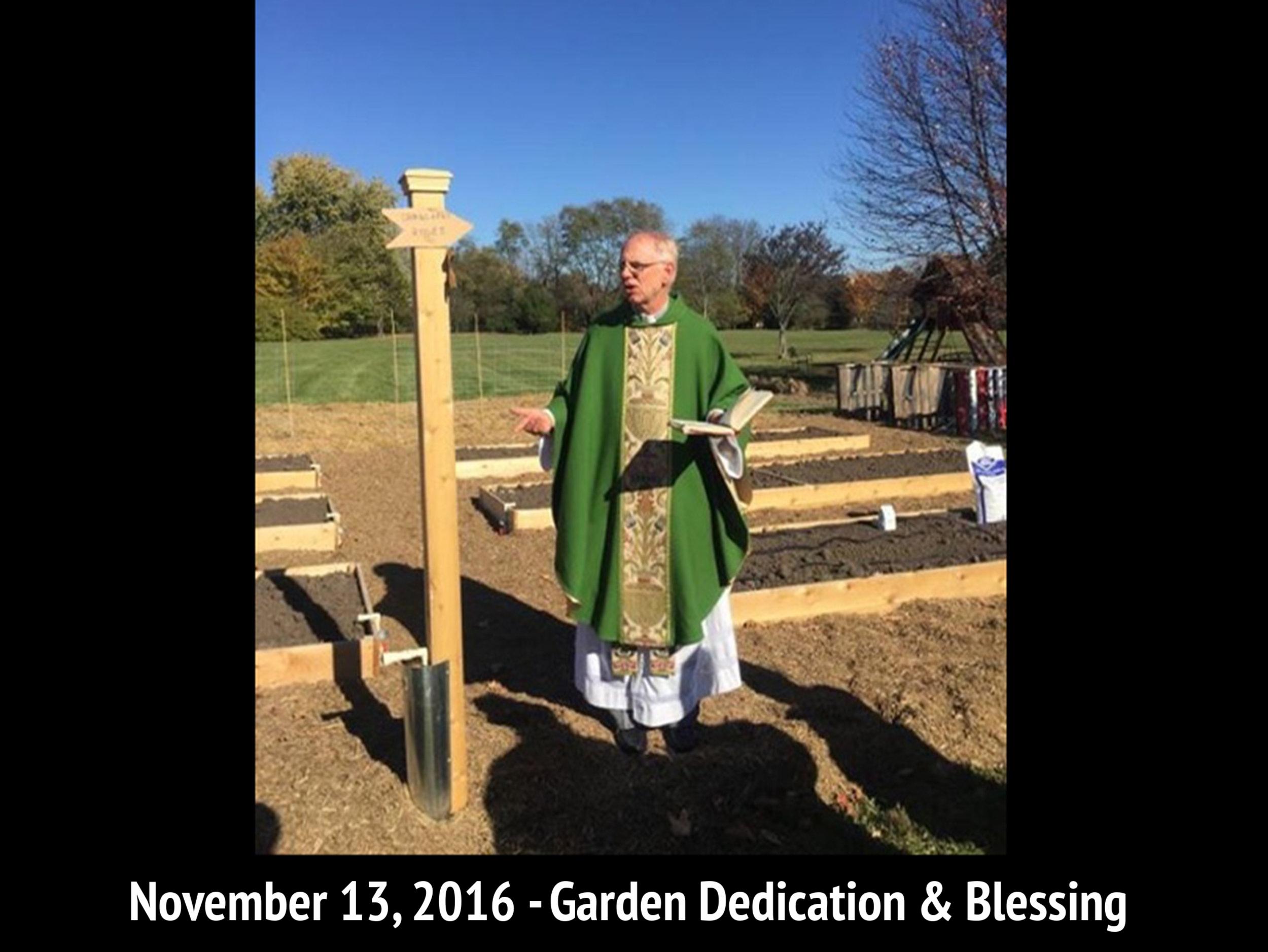 Fr. Lee Schaefer Blessing St. Michael's Community Garden.jpg