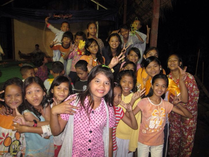 Carolyn (top, middle) with schoolgirls on a trip to Cambodia in July of 2011.