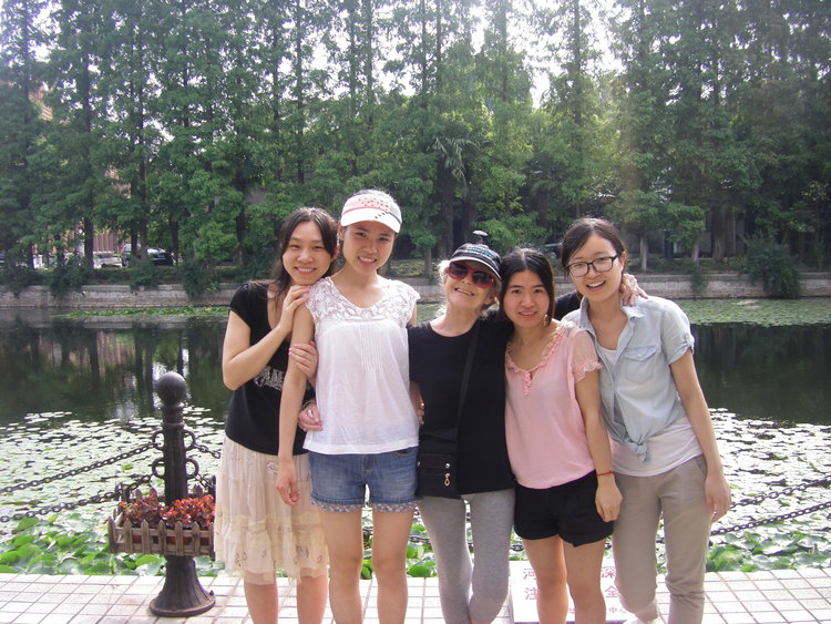 """Anna with her graduated students at ECNU in Shanghai, 2016.""""They were hanging out with me that day after graduation and we went for pizza down the street."""""""