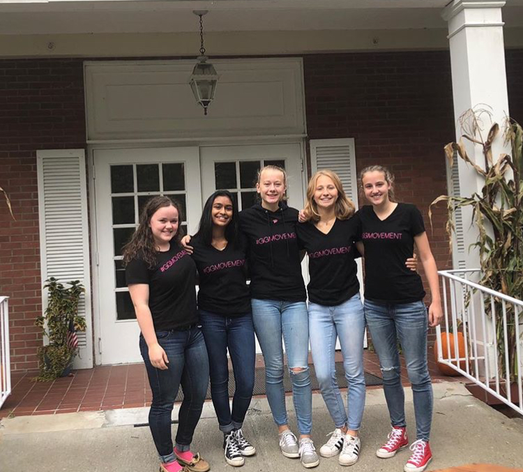 Maggie with other volunteers from her chapter outside the senior center they visit.