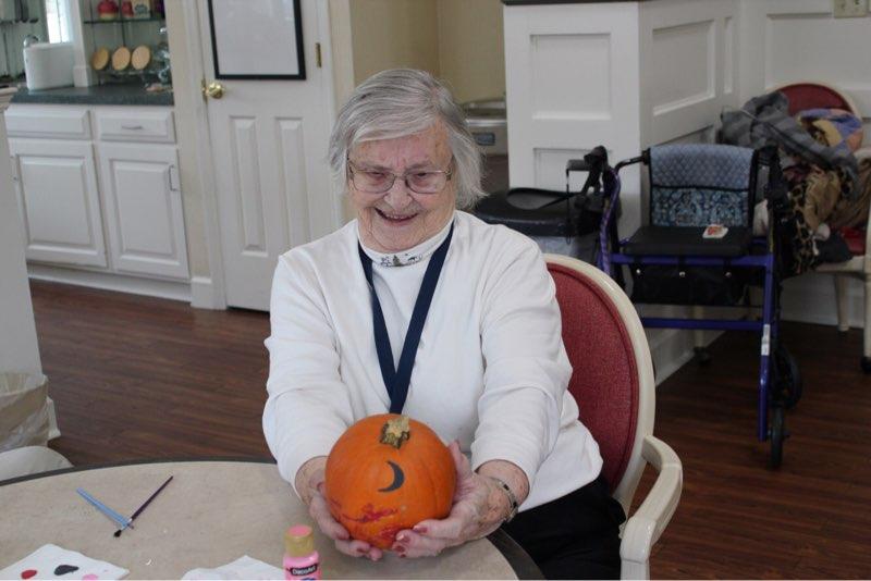 Faye with her beautiful pumpkin from Chris.