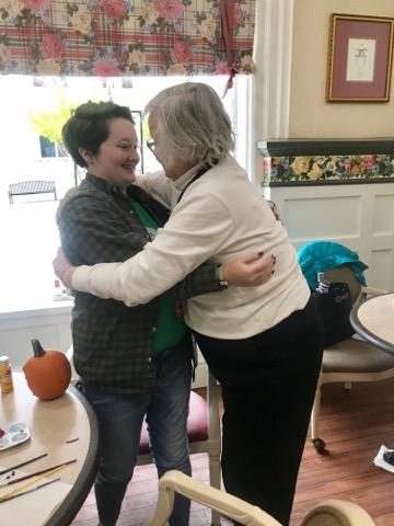 Faye giving Chris a hug after Chris gave Faye her pumpkin.