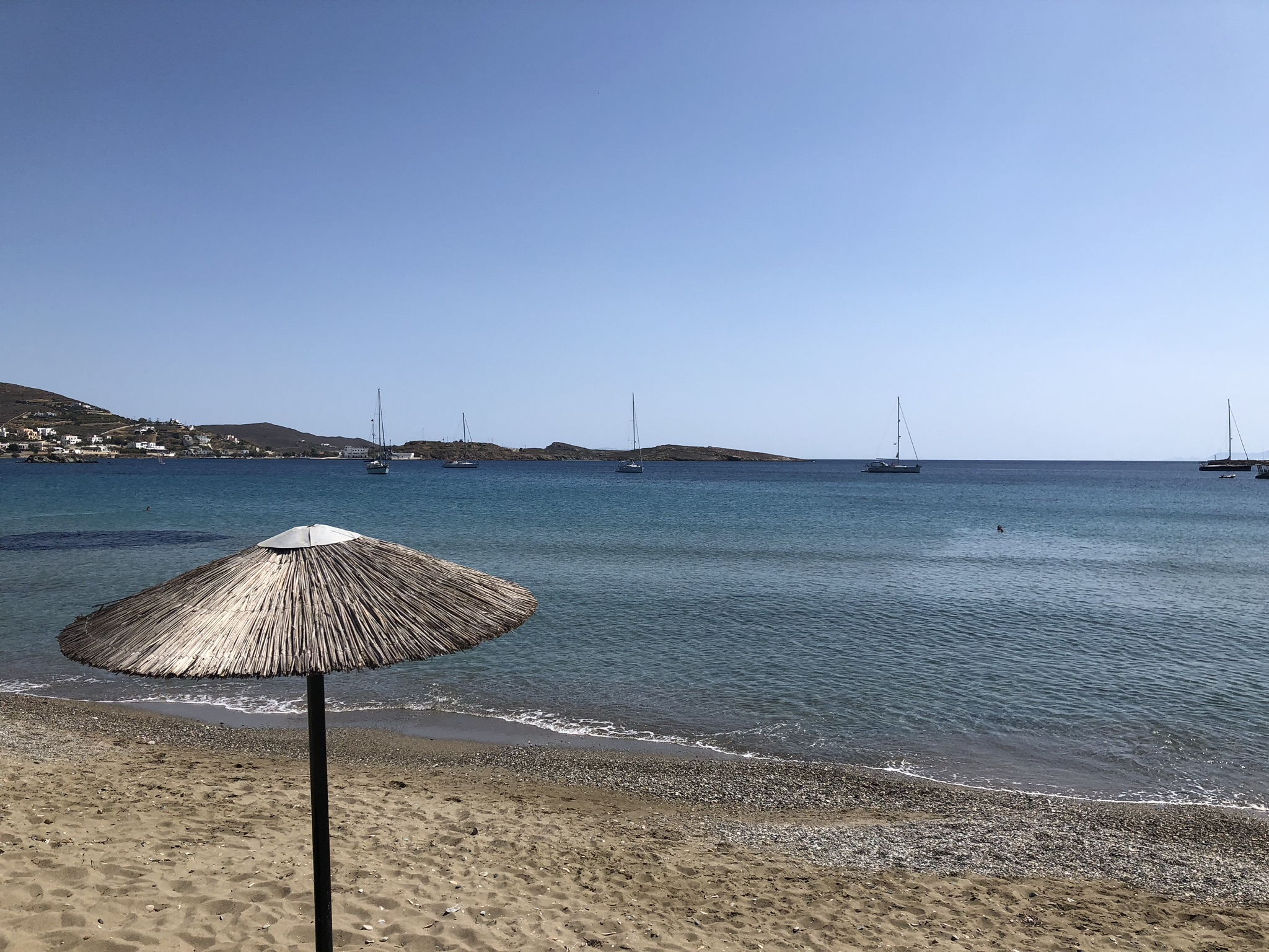 We found a spot under these fun umbrellas and relaxed on the beach in Siros.