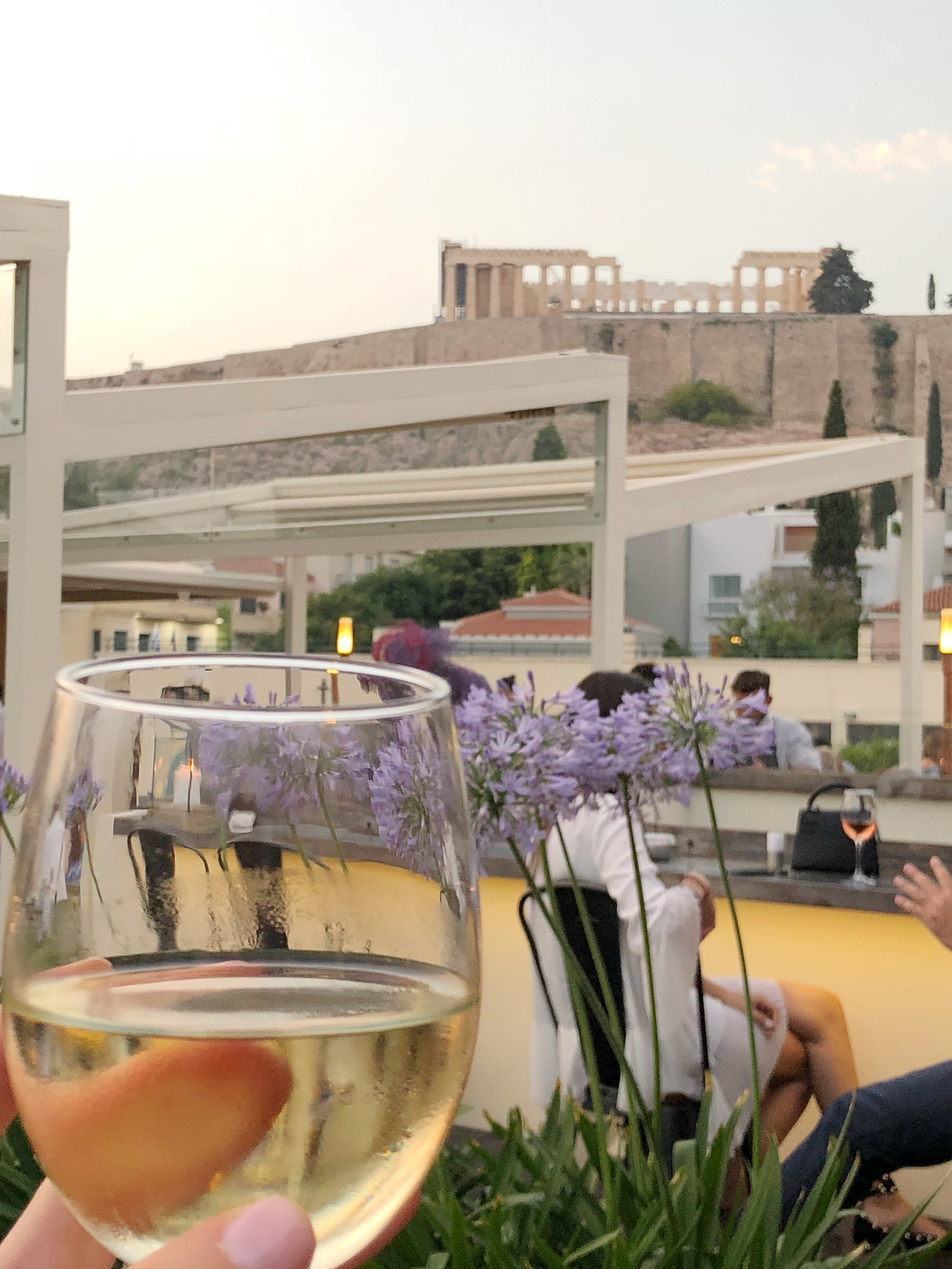 We arrived in Athens just in time to catch the sunset over the Acropolis and have a glass of wine on the rooftop of the Herodion Hotel.