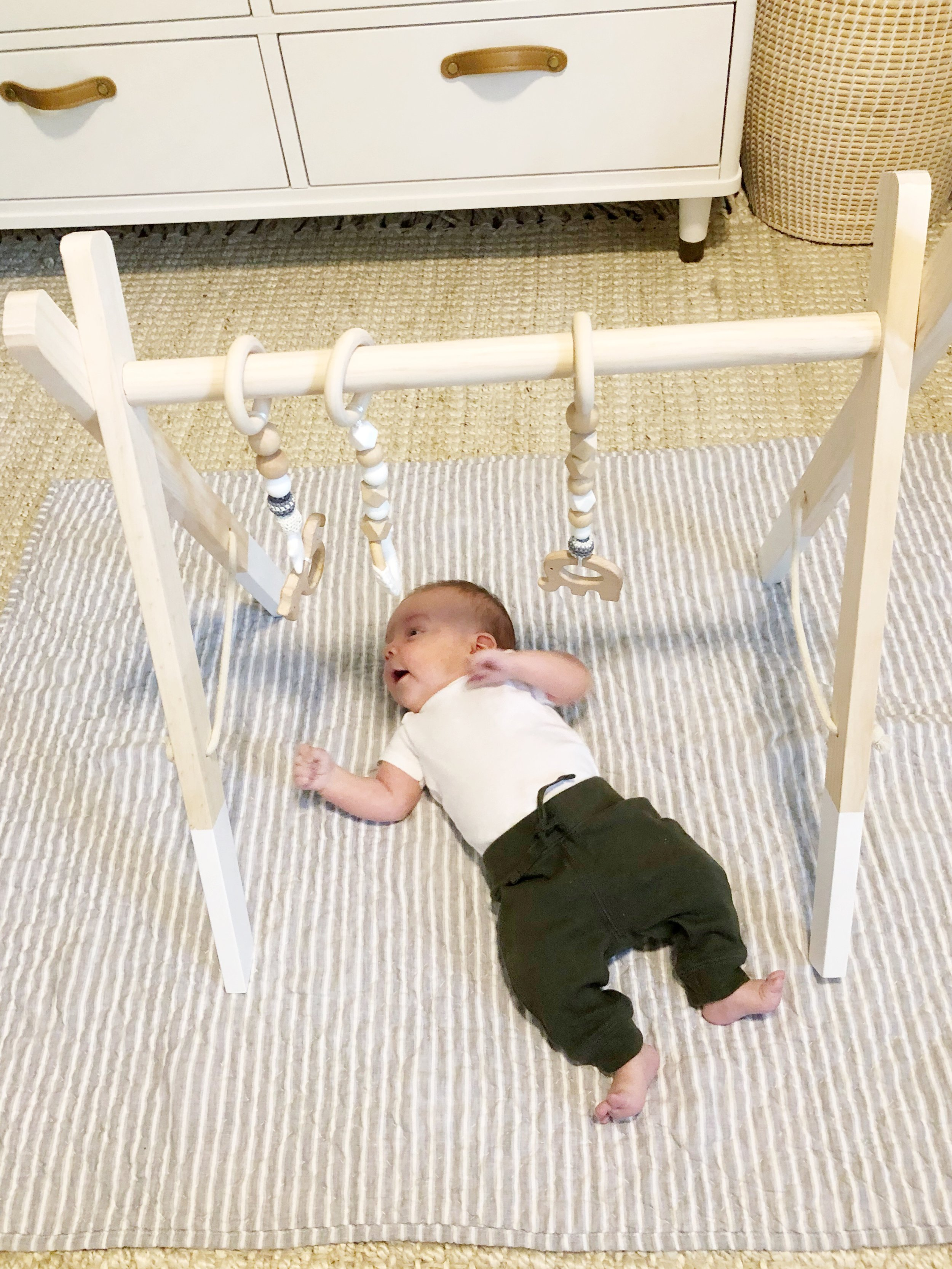 We tried the play gym at 1 month, but he's really getting into it now, at 2 months.