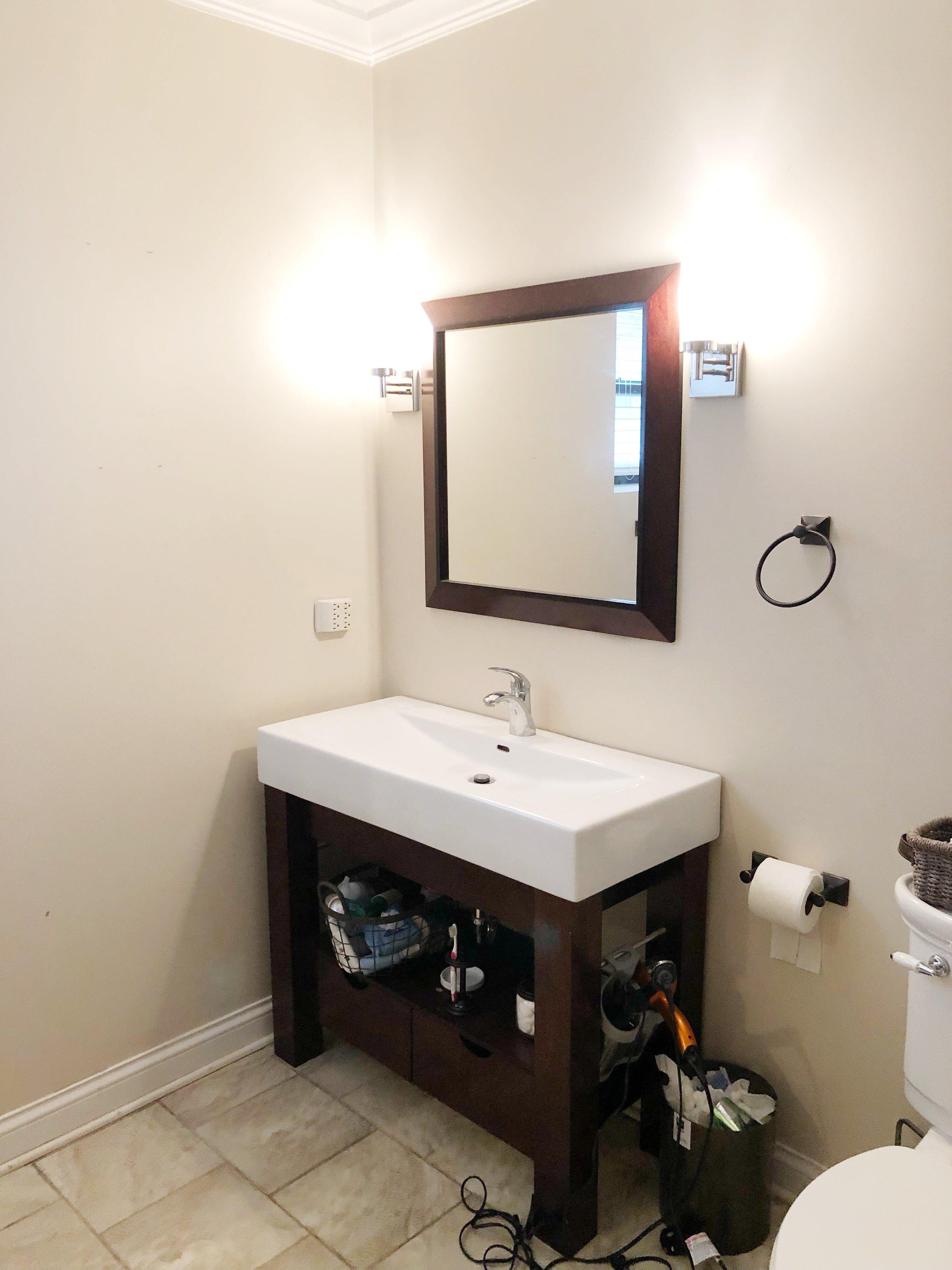 Original vanity & mirror combo. Plus broken trash can with no lid :)