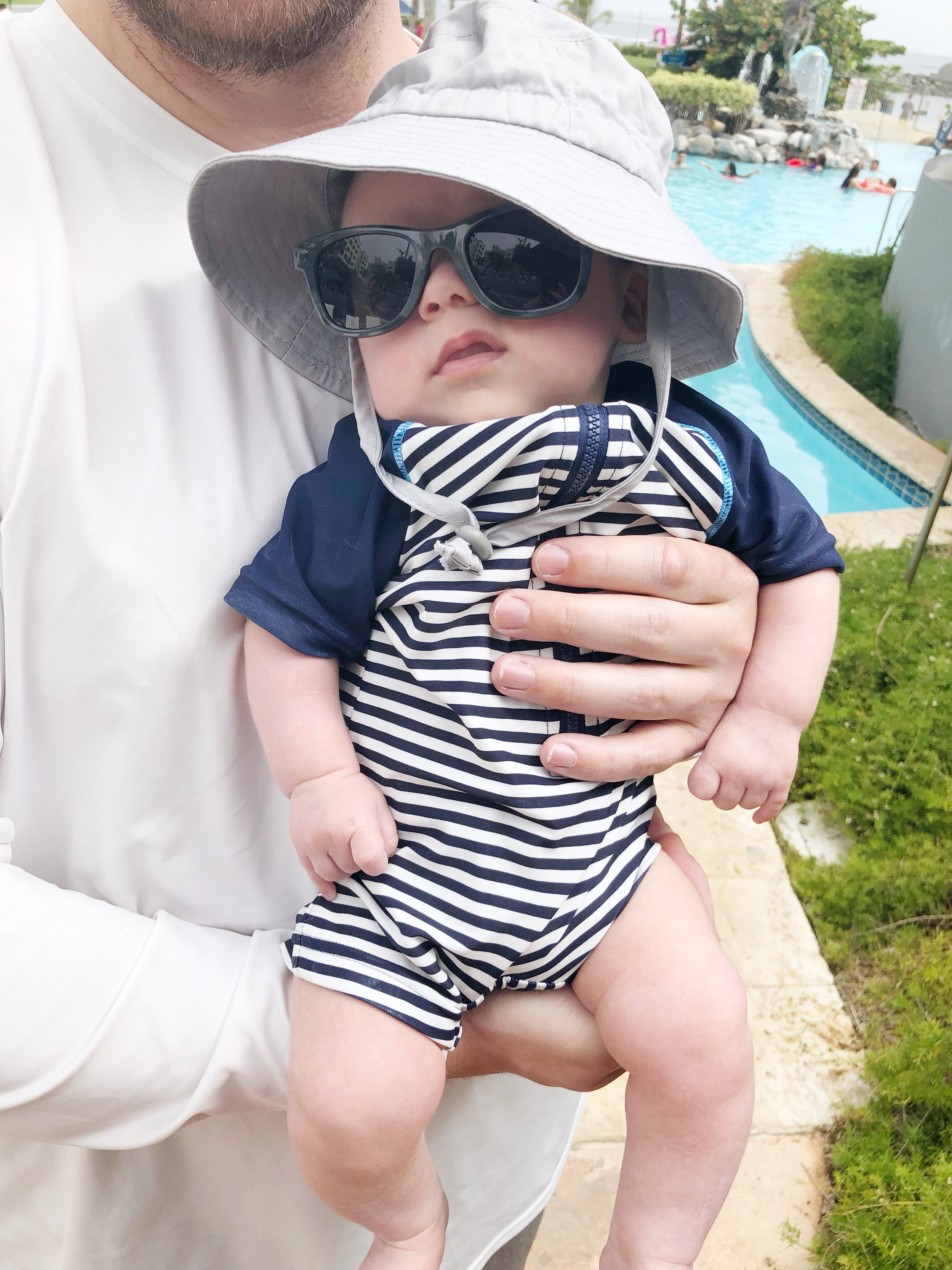 Remy in his sun hat + sunglasses combo.