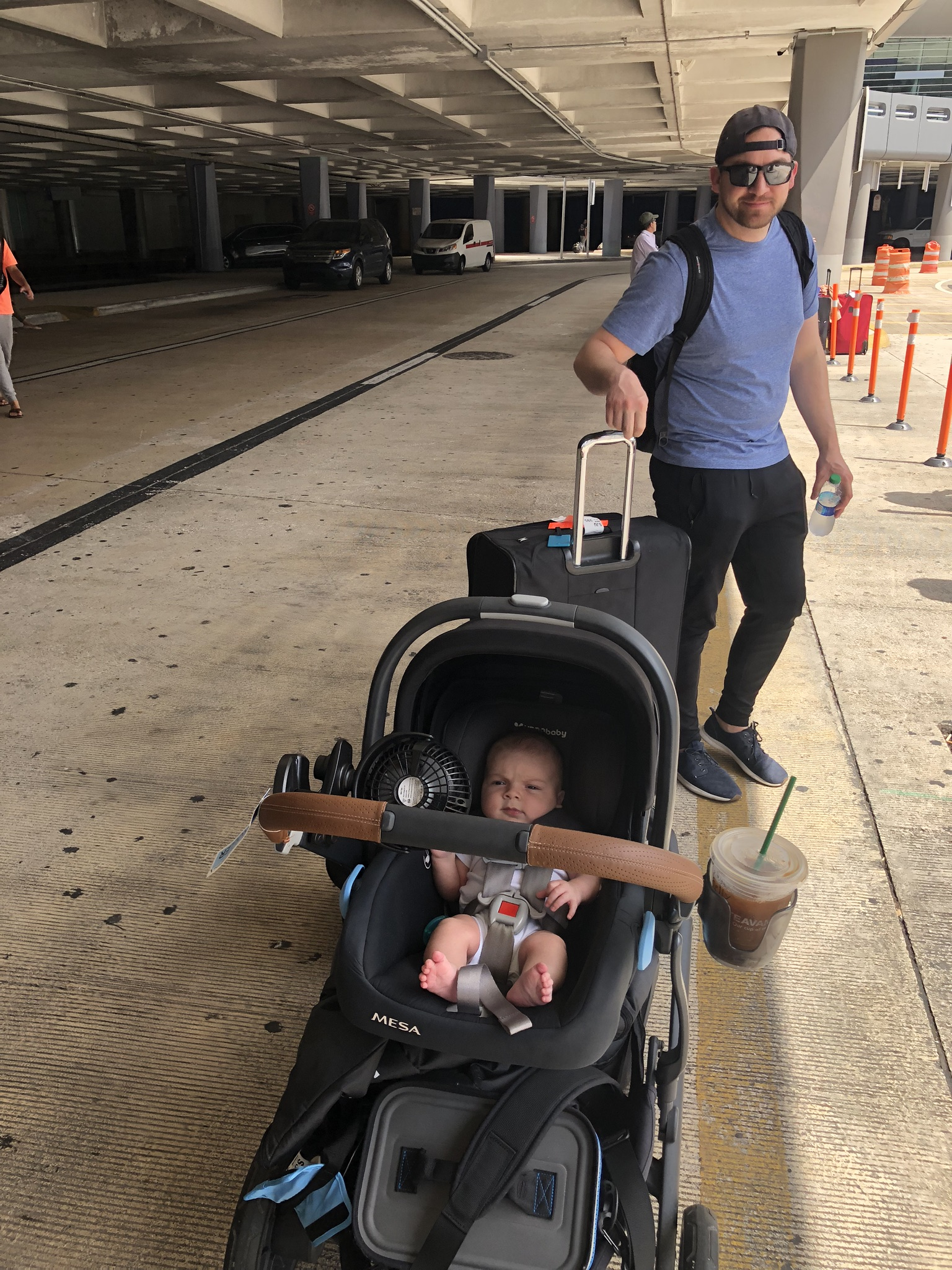 Landing in Puerto Rico. Remy's stroller decked out with all of our gear! And an iced coffee, of course.