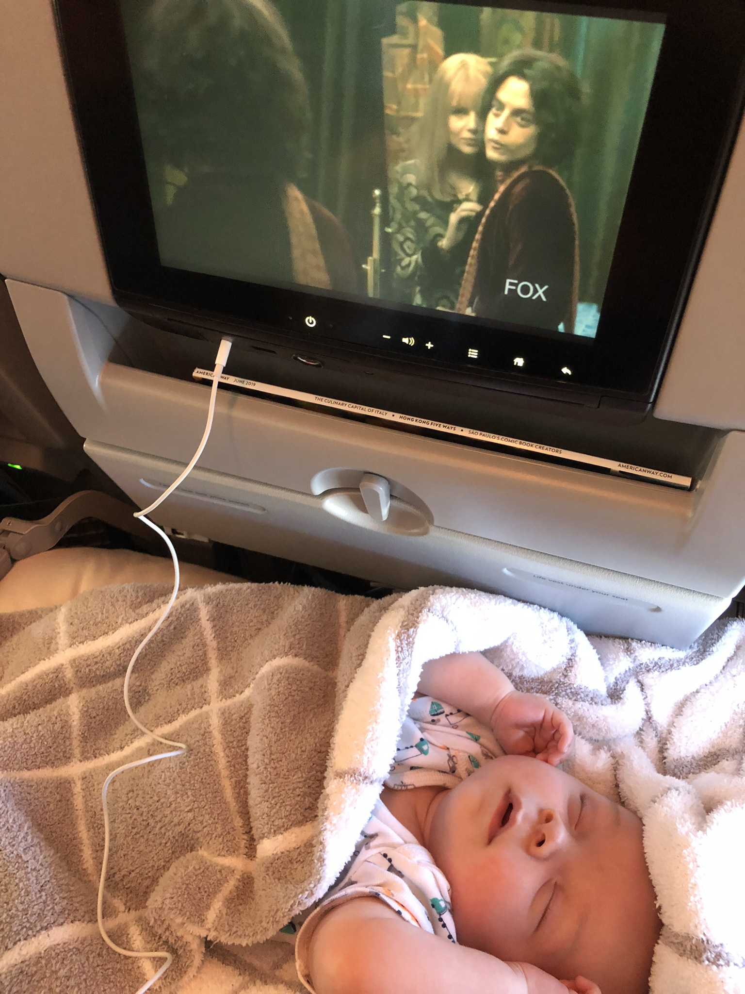 On the flight to Florida, I even got to watch a movie (Bohemian Rhapsody) once he fell asleep!