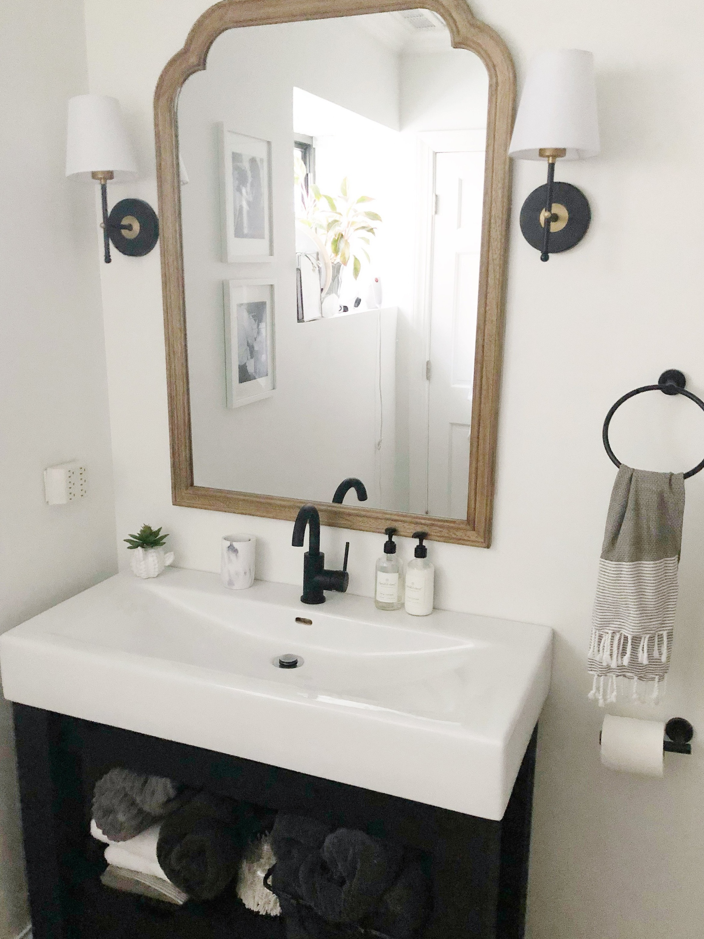 I really love the mirror / sconce combination.