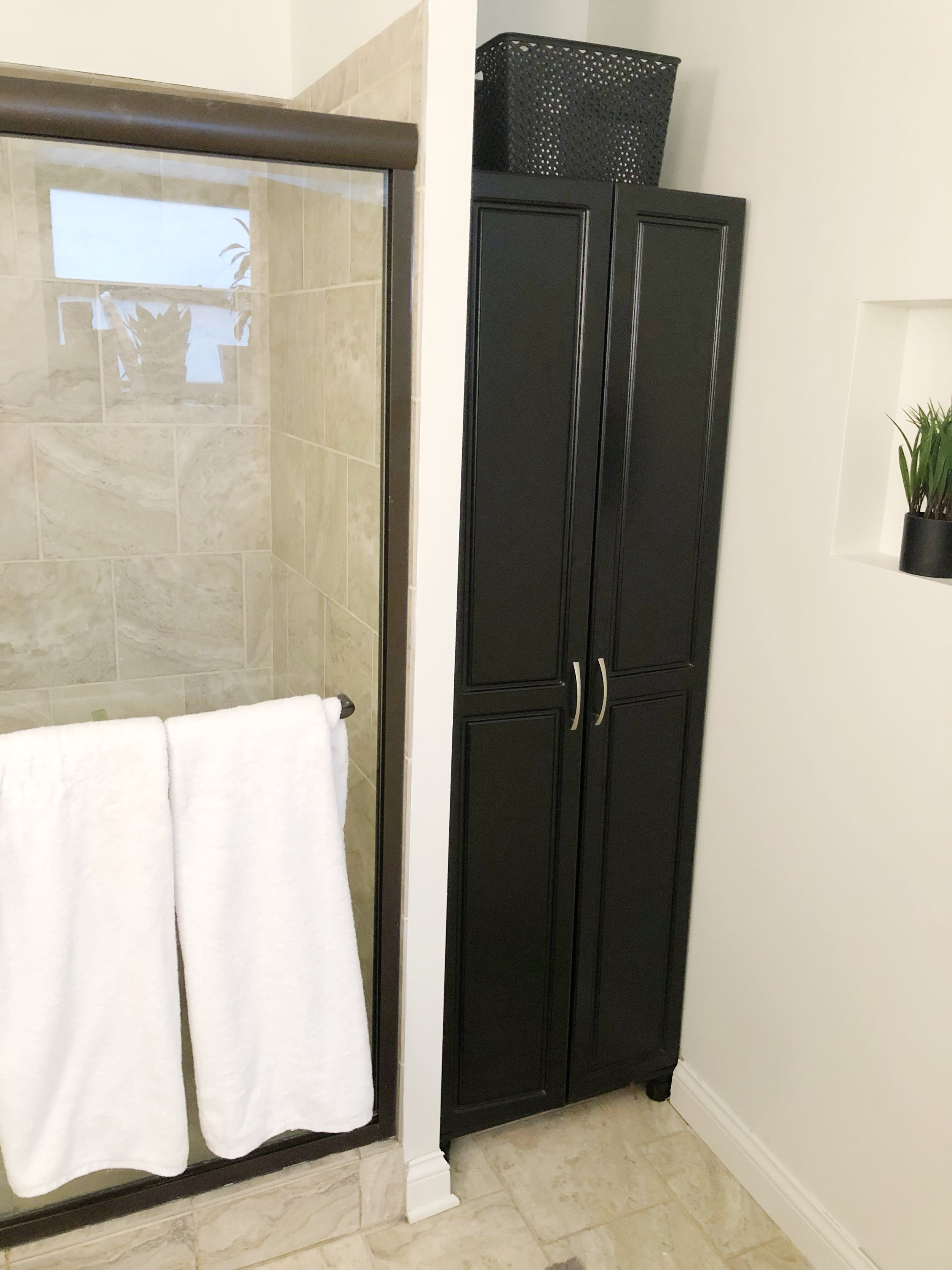 The Scholl cabinet next to the shower really helps hide the unsightly bathroom things. I also hung fresh white towels on the built-in towel rod. I thought, since we have glass doors, this helps to cover up our shampoo / body wash situation inside the shower.