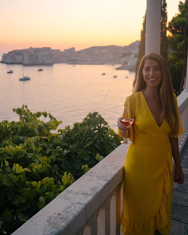 Sunset view from dinner at Villa Orsula on our last night in Dubrovnik✨ The map said our rental car place was only 1.5 miles away so we decided to walk to pick up the car before dinner. We were surprised to find that mile and a half was completely uphill in the crazy summer heat. 😂 I had to rinse off again before dinner and my hair was a hopeless mess from the humidity. At least dinner was amazing. If you're in Croatia, get the local rose, I swear it's the best I've ever had! 🍷 What's your favorite wine?? #croatiafulloflife #roseallday #gltlove #traveltuesday #dametraveler #sheisnotlost #dubrovnikcroatia #sidewalkerdaily #femmetravel #globelletravels #liketkit #kingslanding #travelgram #agameoftones #got #topshopstyle #yellow #houstonblogger #darlingescapes #pursuepretty #buildandbloom #sunset