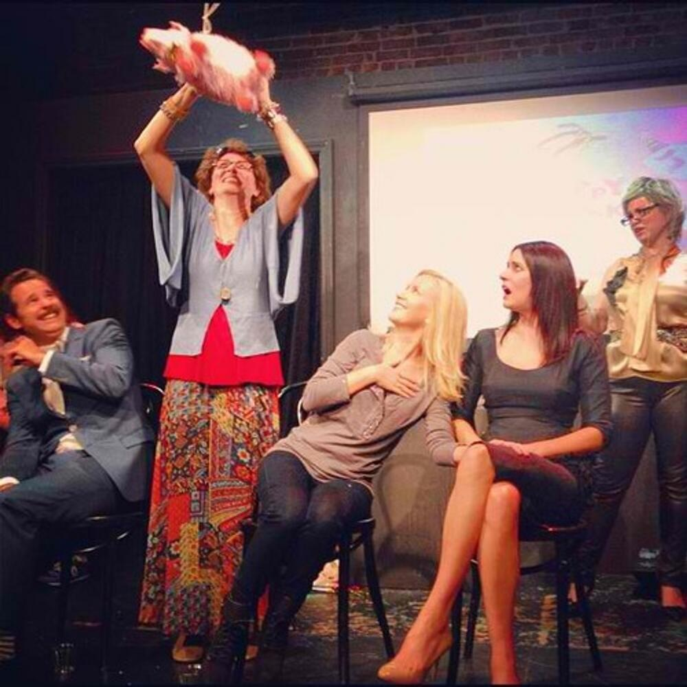 Paul F. Thompkins, Beverly Ginsberg (Jamie Denbo), Angela Kinsey, Paget Brewster, and Ronna Glickman (Jessica Chaffin) on stage at the Upright Citizens Brigade