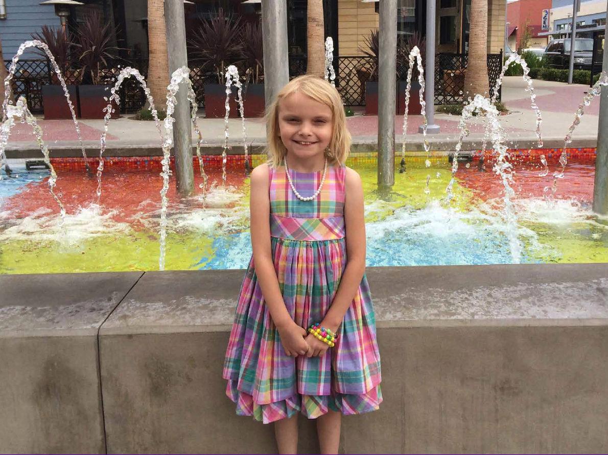 Mary Ellen in front of fountain LG.jpg