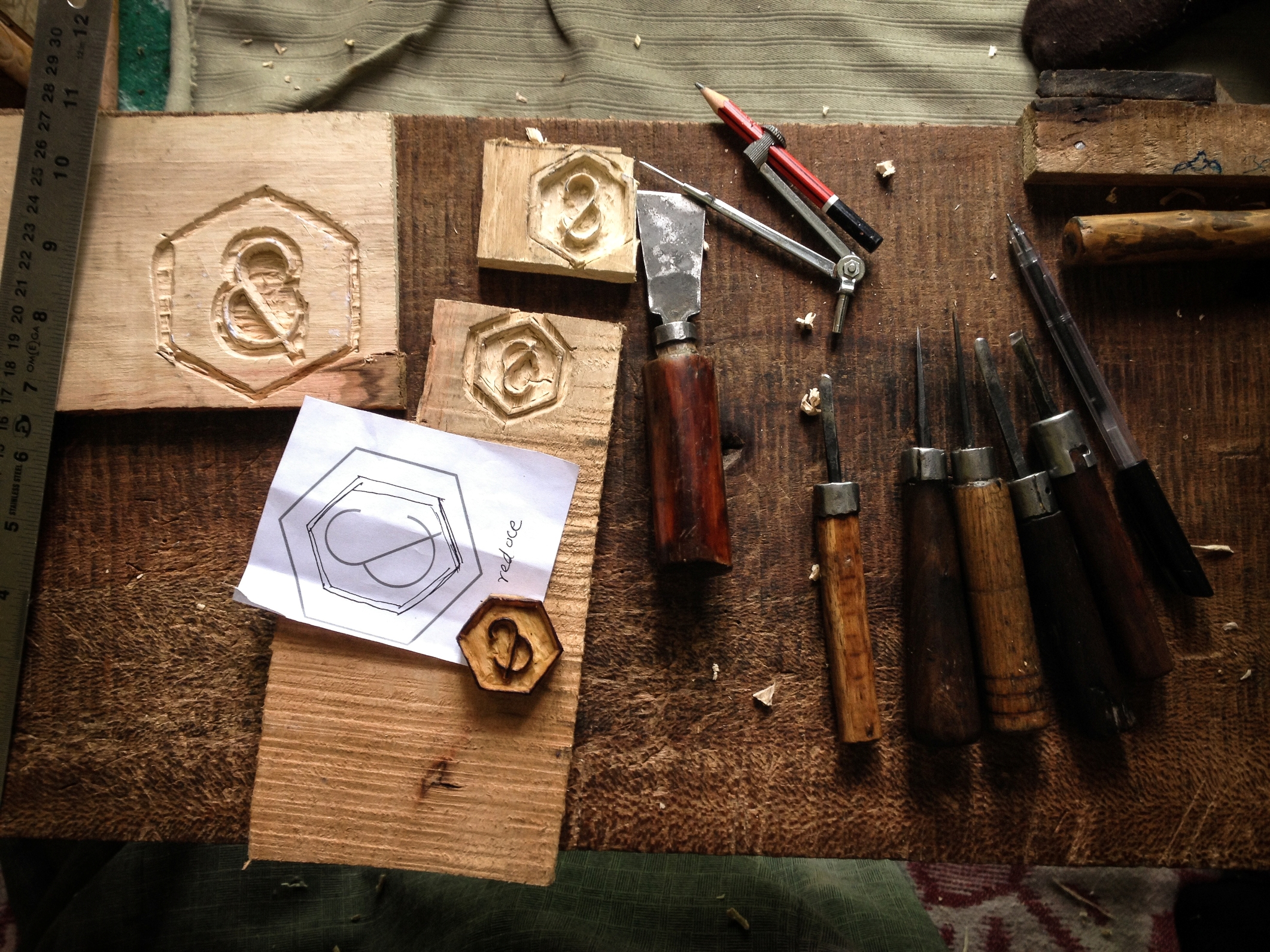 Jos&fine's logo being carved in wood