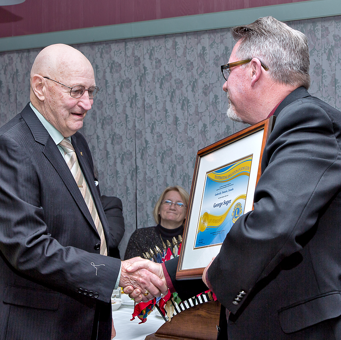 The Goderich Lions Club honoured  Lion George Sager  with a LCI Life Membership.   Lion George is presented with his award by Lion President Jim Crow.
