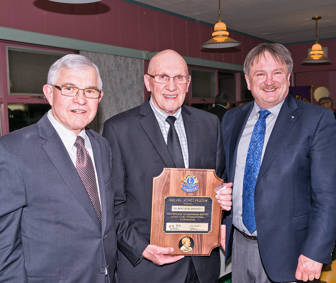 Lion President, Bob Robson and Lion John Grace present  Delbert (Deb) Shewfelt  with his Melvin Jones Fellowship Award.  As former Goderich Mayor, Deb was untiring with his work as a community leader.  Deb served as Councillor, Reeve and Mayorfor over 28 years.  He was a Huron county Councillor for 18 years, and Warden in 2008.   The results of Deb's leadership are visible throughout our Town through things like Doctor Recruitment, the Maitland Recreation Centre, the Maitland Valley Medical Centre and the recovery after the 2011 Tornado.  These were a few of the many reasons why Deb was chosen for this award!