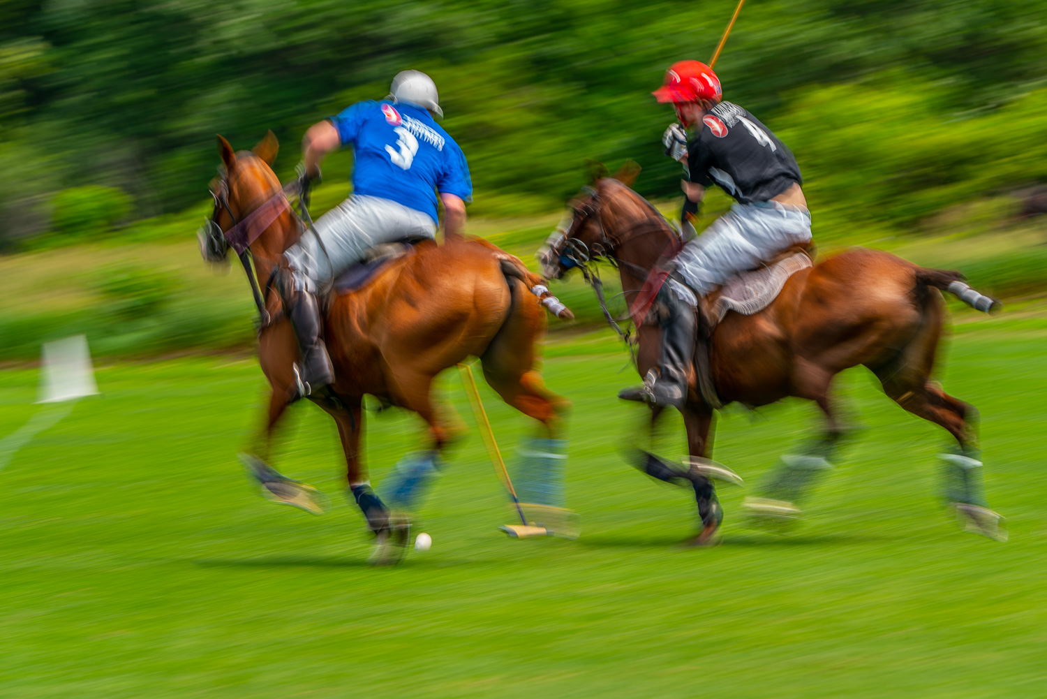 _Battling for the ball at the Mashomack Polo Club in pine plains, ny.  Blurs create a sense of speed in the image..jpg