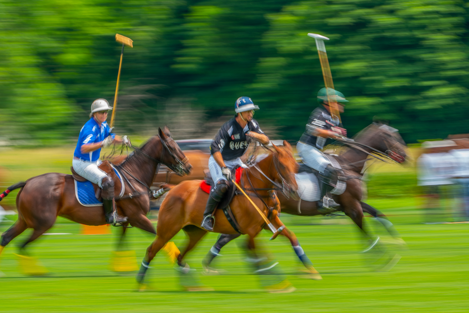 polo players racing for the ball in a blur at the mashomack polo club in pine plains.jpg