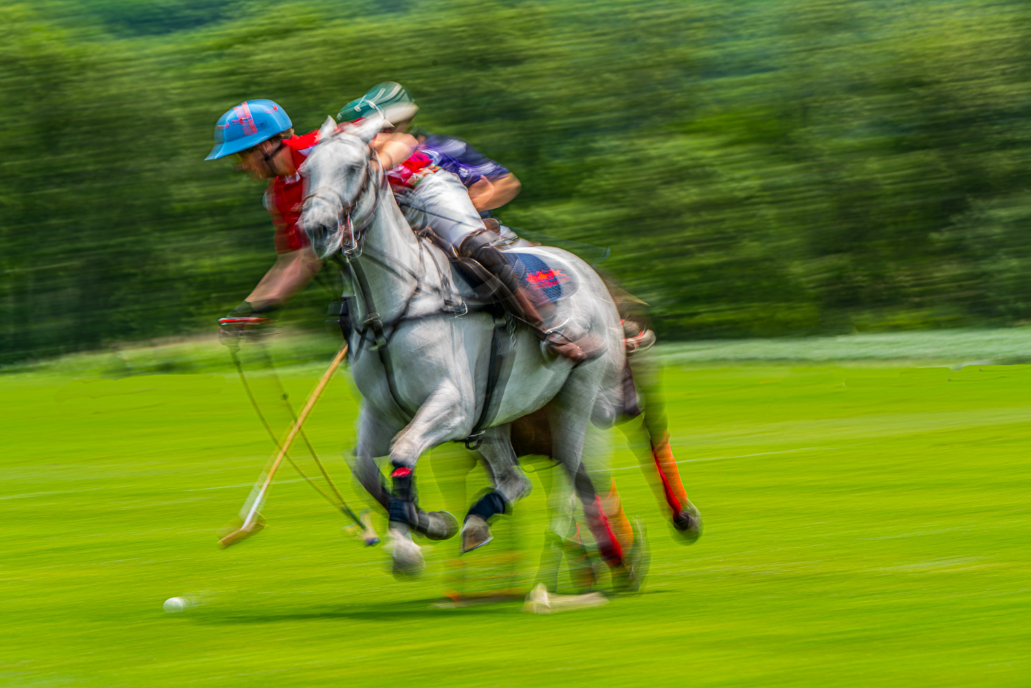 Watch the mallot flex as the polo player is about to hit the ball at the mashomack polo club in Pine Plains, ny.  The action blur creats a sense of speed and movement..jpg