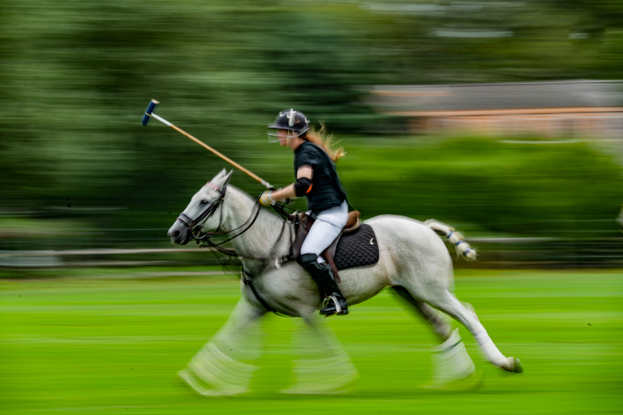 one of the women polo players  at the Southampton Polo Club in flight.jpg