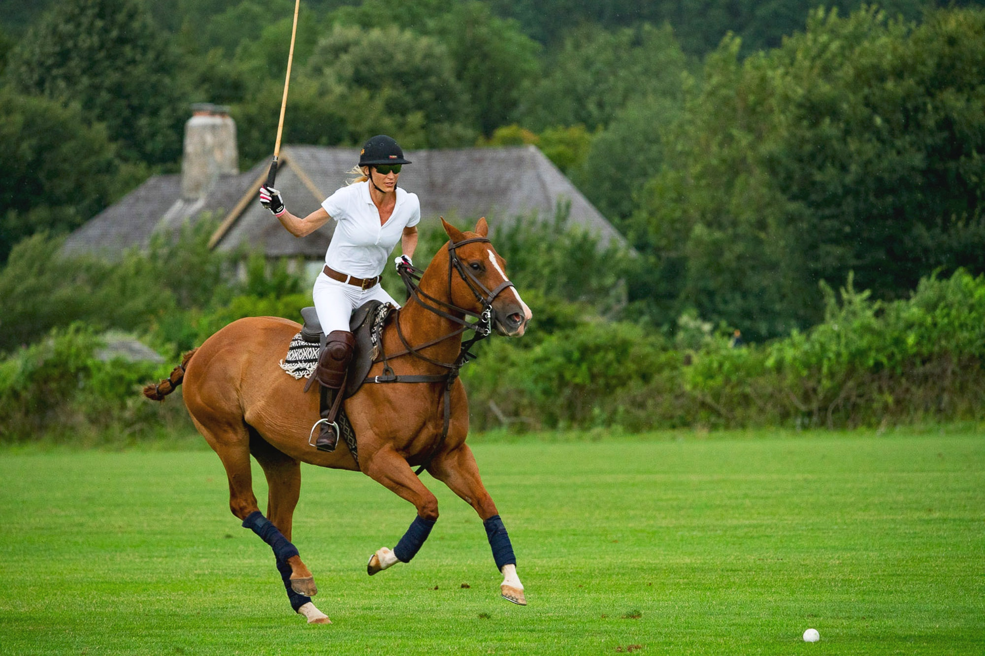 Danielle tosi one of the women polo playuers at the Southampton Polo Club takes a swing. Woment mix it up with the men. Intermural..jpg
