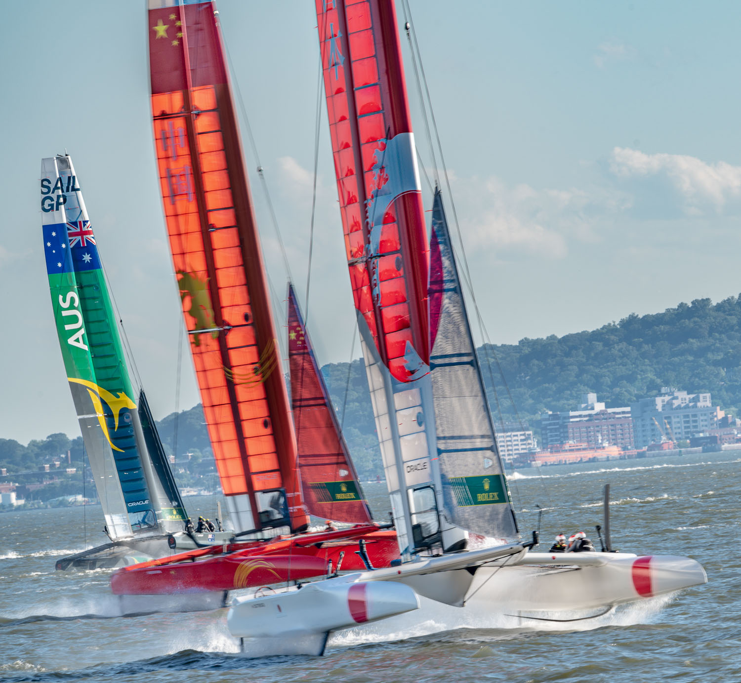 Battling for the lead in the Sail GP race on the Hudson.,  the cats are all riding on hydrofoils..jpg