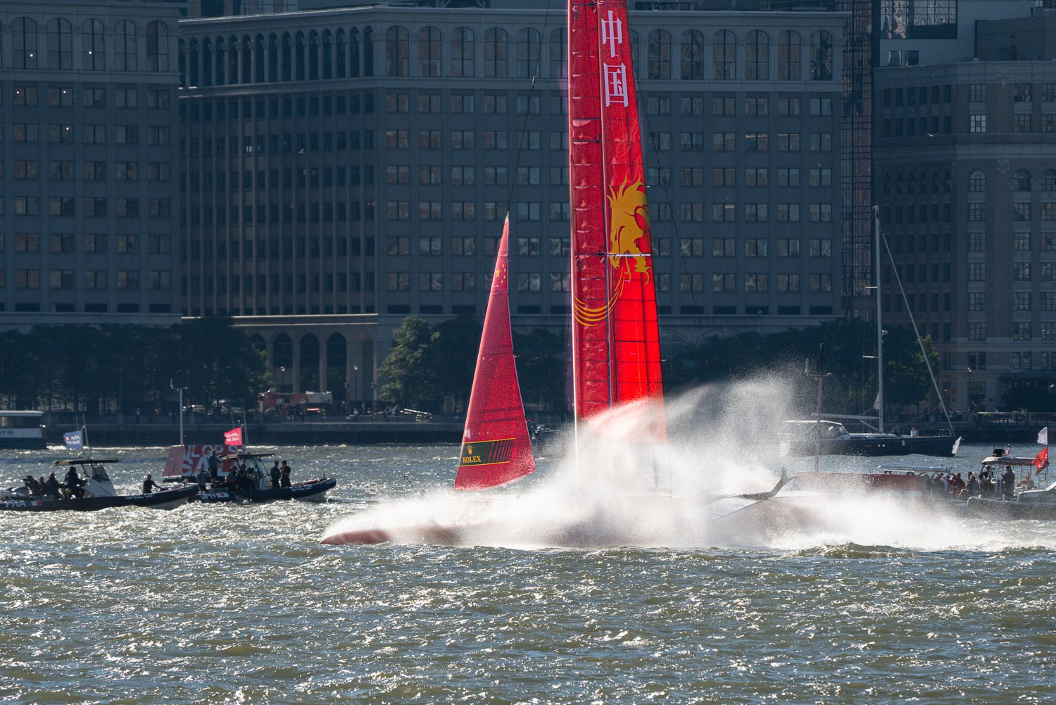 China'sSail GP boat encounters problems as it decellerates from it's hydrofoils into a choppy hudson river. Jersey city is in the background..jpg