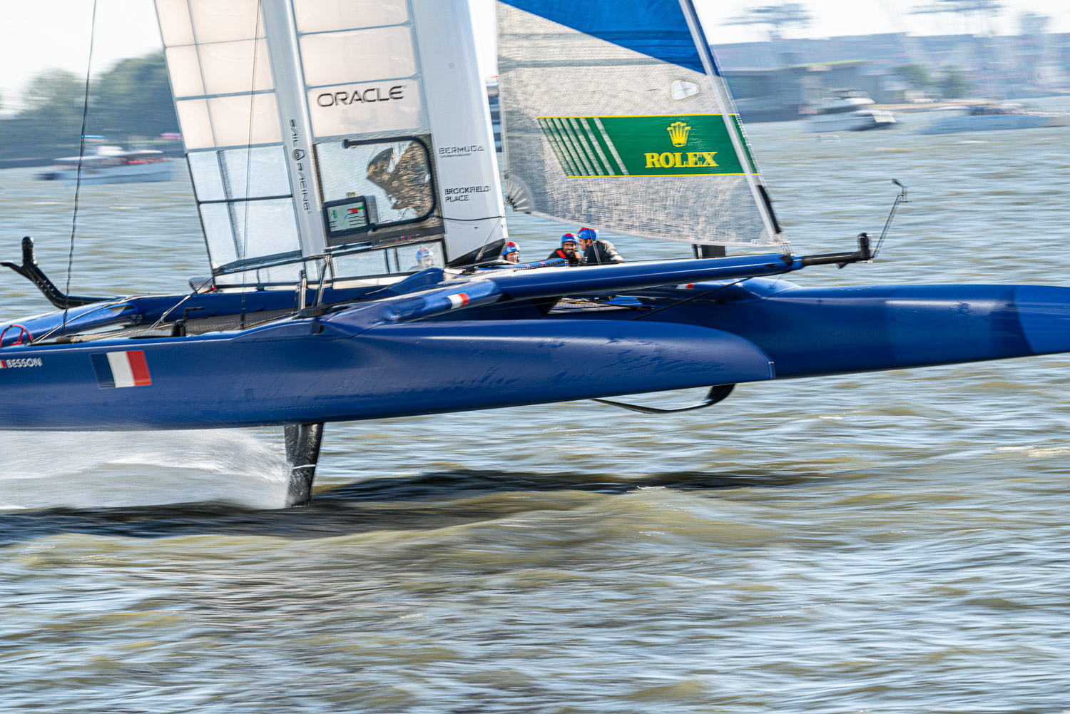 Great Britian Sail GP boat flying by the stuatue of liberty on her hydrofoils.  Speeds reach 60 mph and the boat barely touches the water. These cat boats are insane..jpg