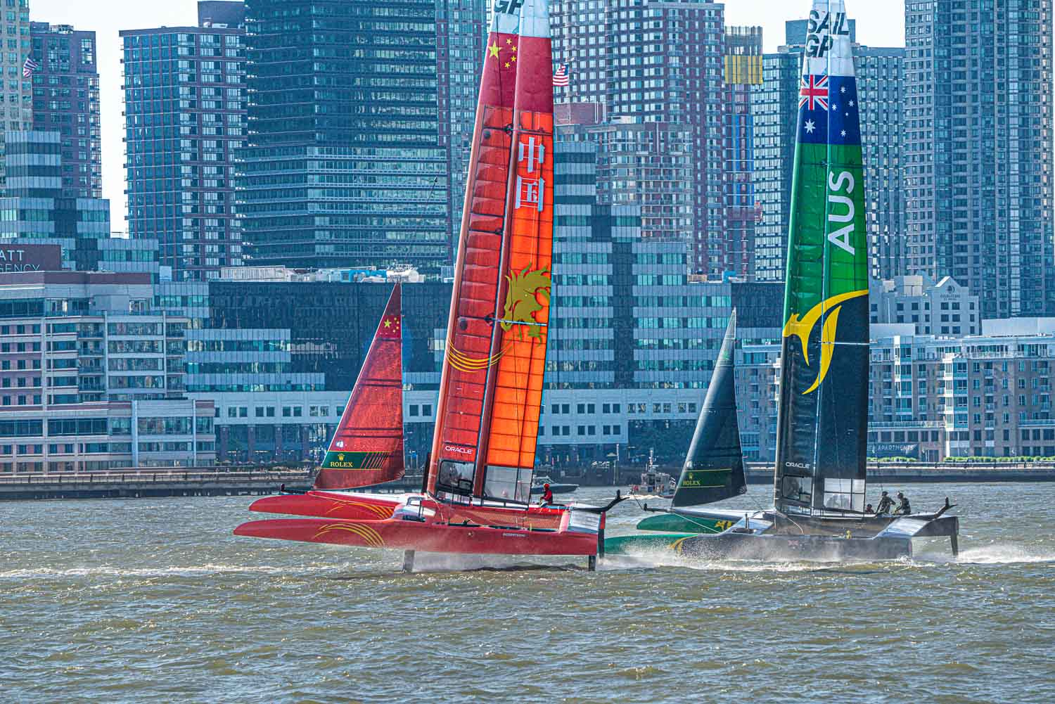 With Jersey City in the background the Sail GP race on the hudson begins.  Boats accelerater onto their hydrofoils almost immediately.jpg
