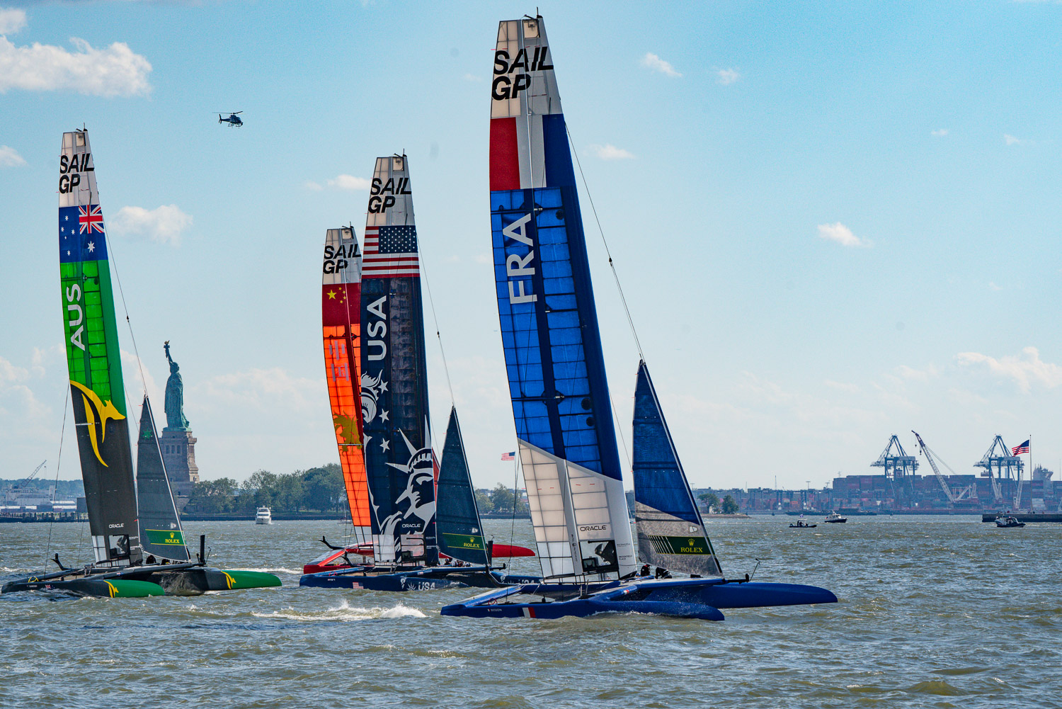 The sail GP boughts are in a tight race at this point. The statue of liberty sits in the background on the Hudson River.jpg