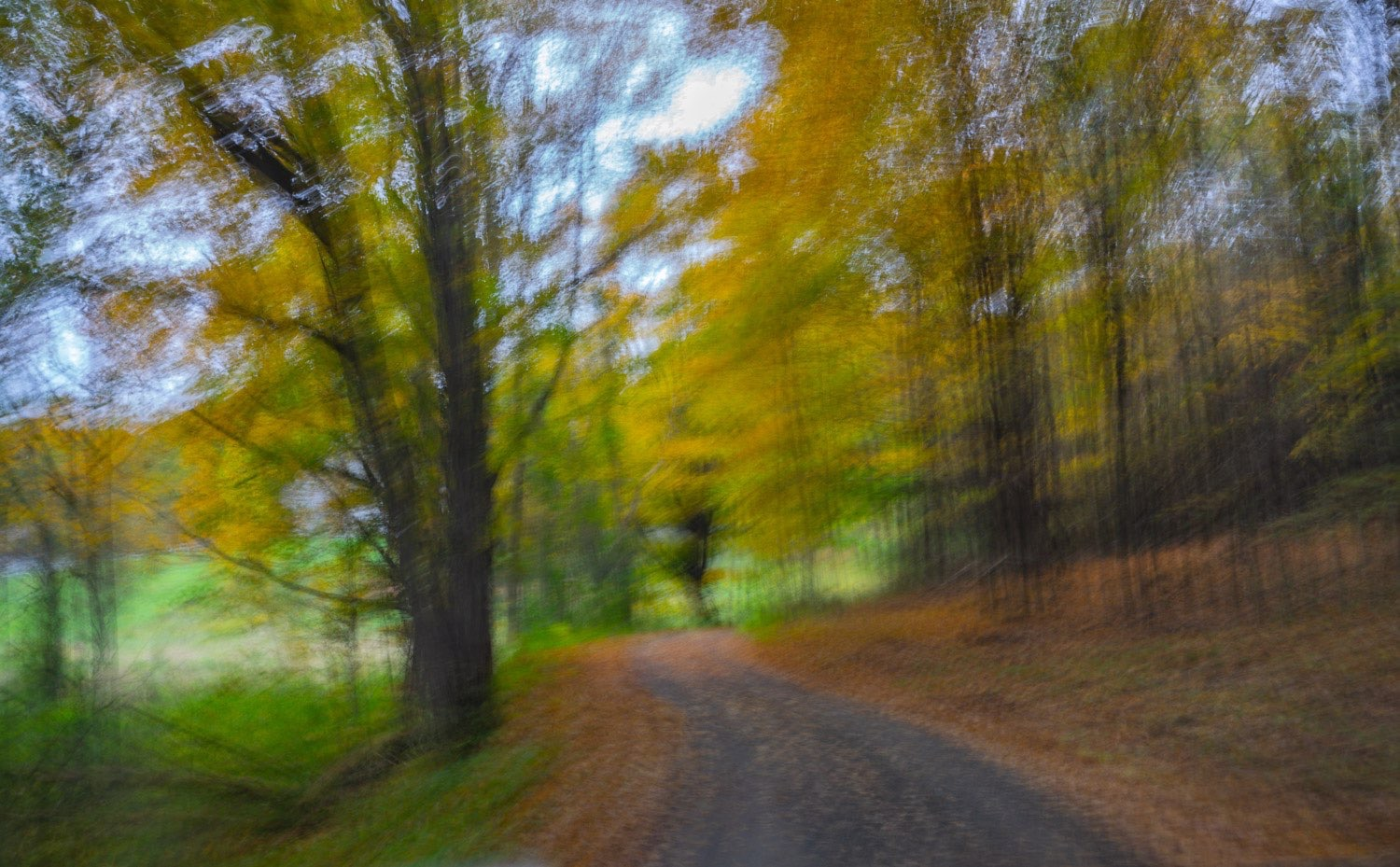 Tranquil abstract photograph with blurred movement  of a country road in the autumn. fall.  johnstuartstudio-compress.jpg