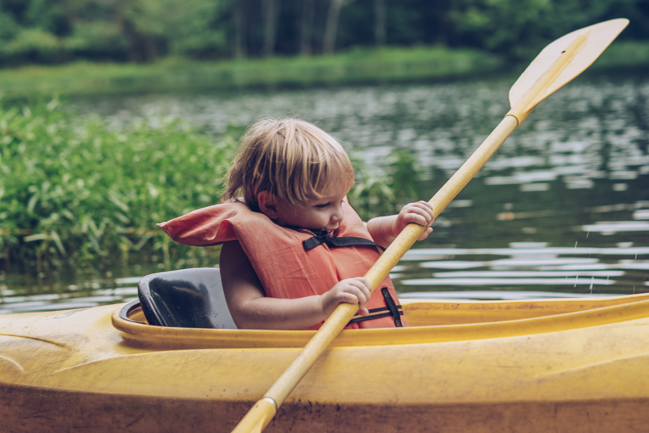 I don't see any problems with tiny Taters paddling a kayak in his oversized life vest