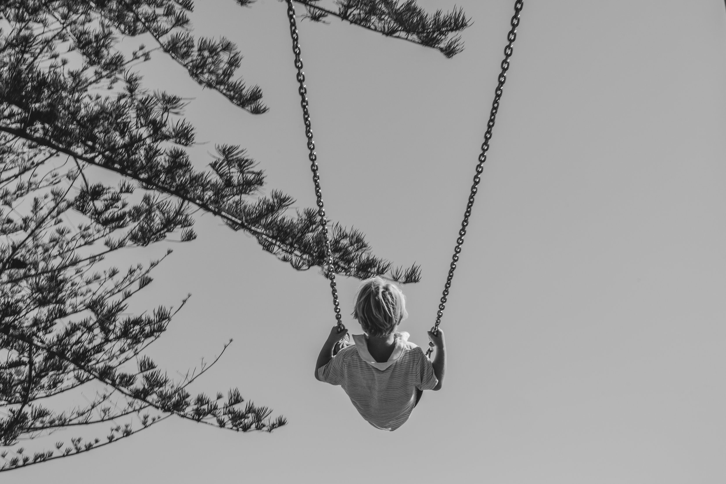 Tater swinging at Apex Park in Byron Bay