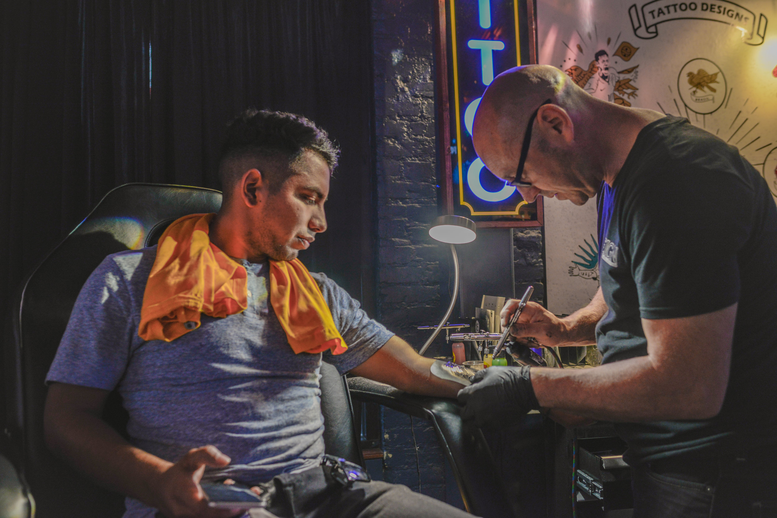 Temporary airbrush tattoos being applied at the Fox Sports Bar
