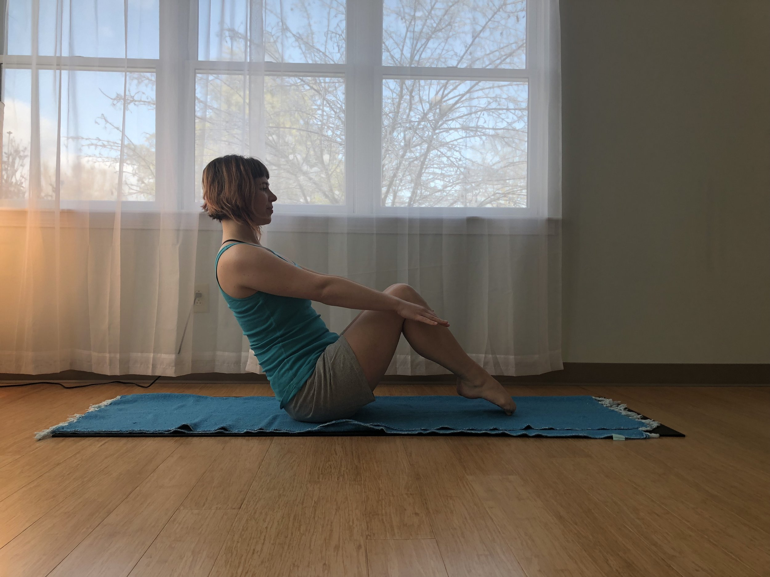 3. Breathe in & Lengthen spine