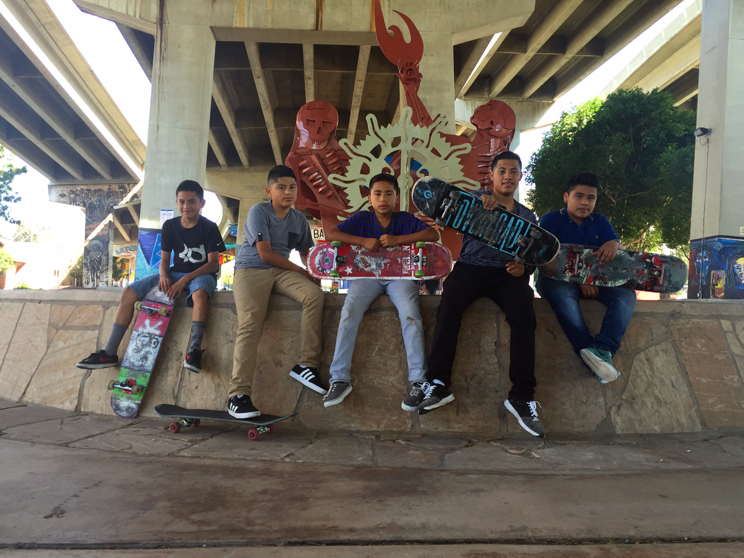 Chicano Park Barrio Logan skate crew San Diego, CA  ©  Jud Burgess 2016  6 months later Laurie and I are on the other side of the country in San Diego and I convince this young group of Chicano skaters to sit for a portrait.  Surfing concrete under concrete.