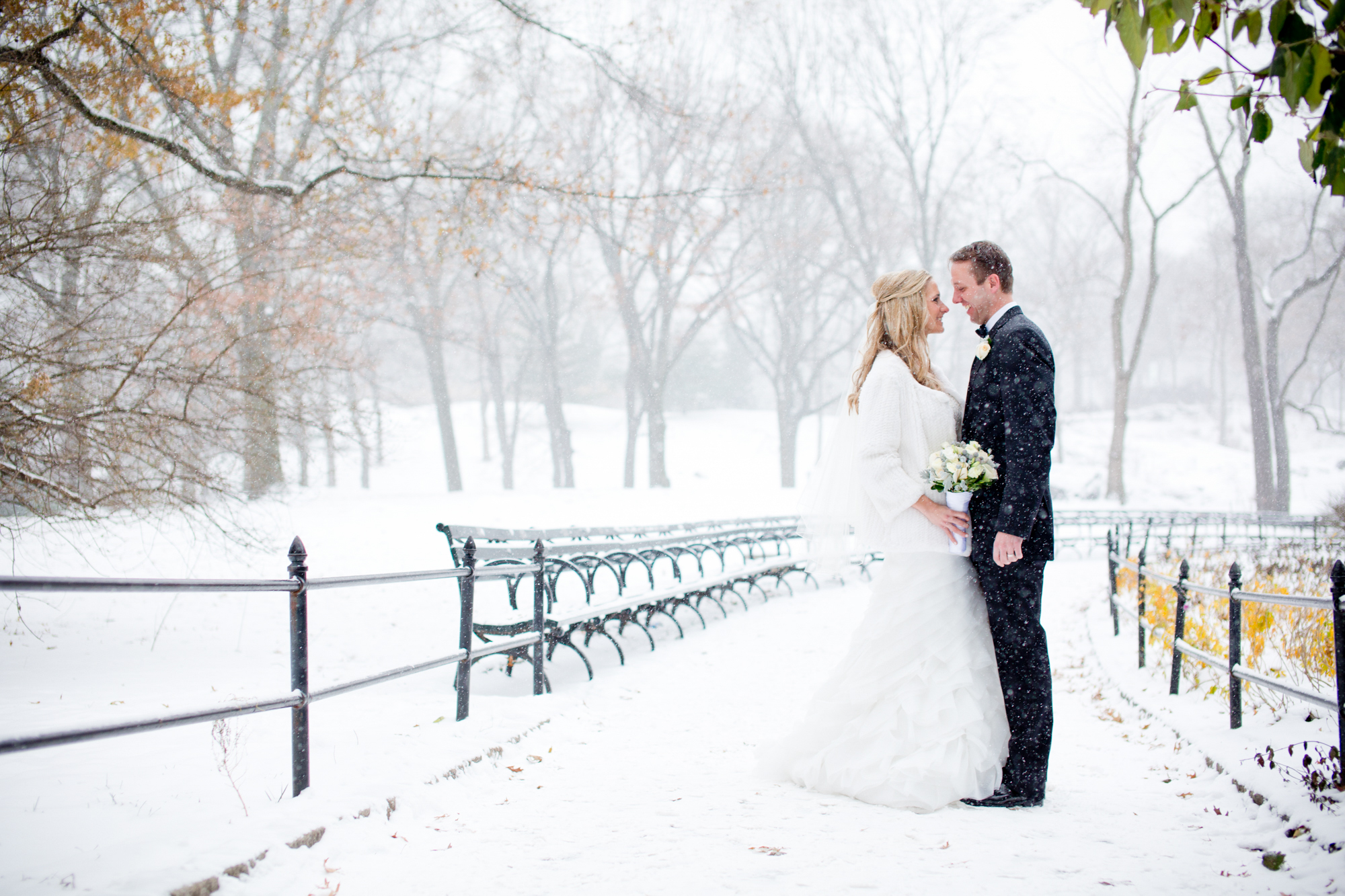 068_CarlyGaebe_SteadfastStudio_WeddingPhotography_NewYorkCity_CentralPark_Winter_Romantic_Snowing_Bride_Groom_Bouquet_Ring.jpg