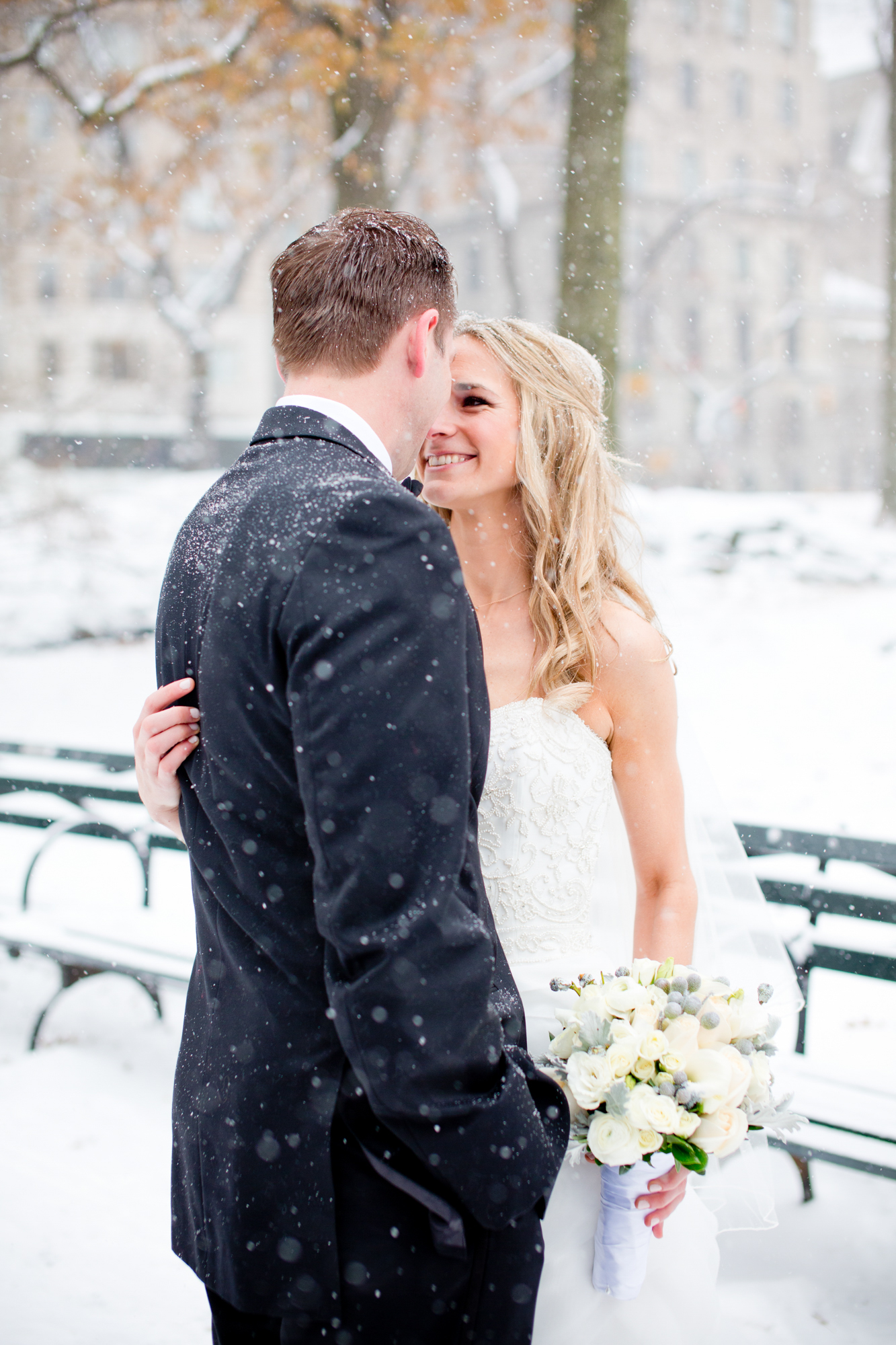 070_CarlyGaebe_SteadfastStudio_WeddingPhotography_NewYorkCity_CentralPark_Winter_Romantic_Snowing_Bride_Groom_Bouquet_Ring.jpg