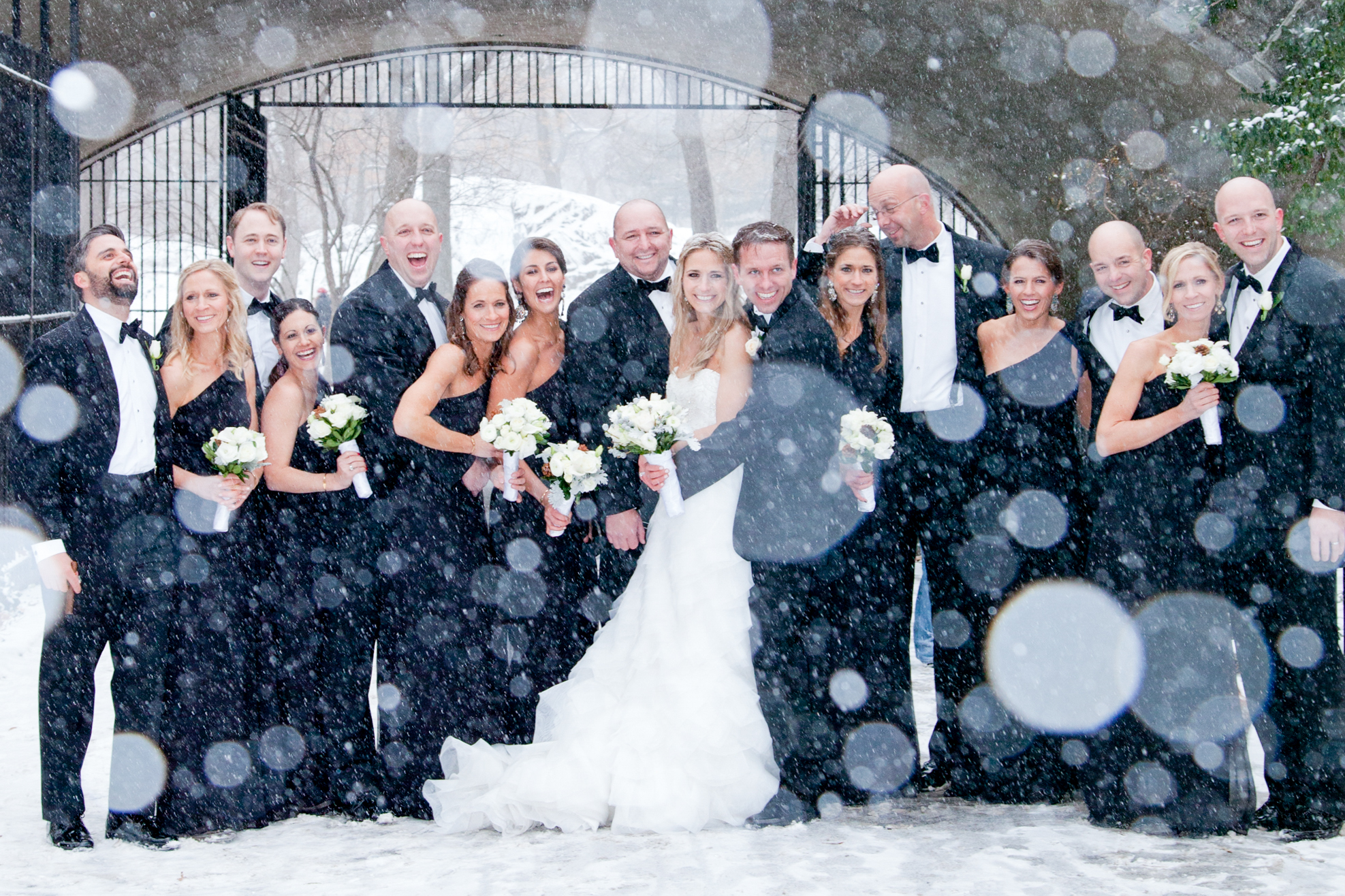 071_CarlyGaebe_SteadfastStudio_WeddingPhotography_NewYorkCity_CentralPark_Winter_Romantic_Snowing_Bride_Groom_Bouquet_Ring_WeddingParty.jpg