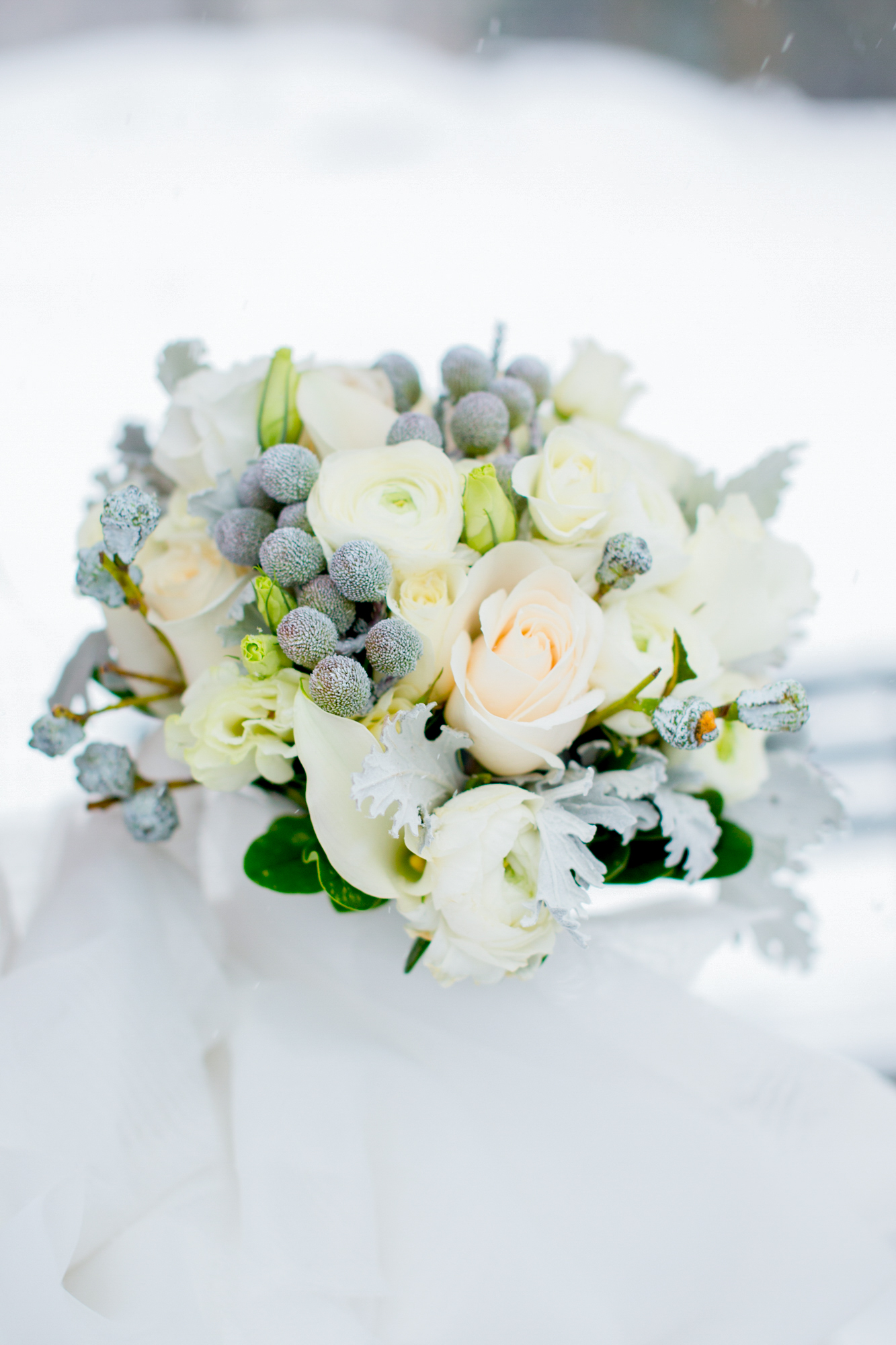 073_CarlyGaebe_SteadfastStudio_WeddingPhotography_NewYorkCity_CentralPark_Winter_Romantic_Snowing_Bride_Groom_Bouquet_FloralArrangement.jpg