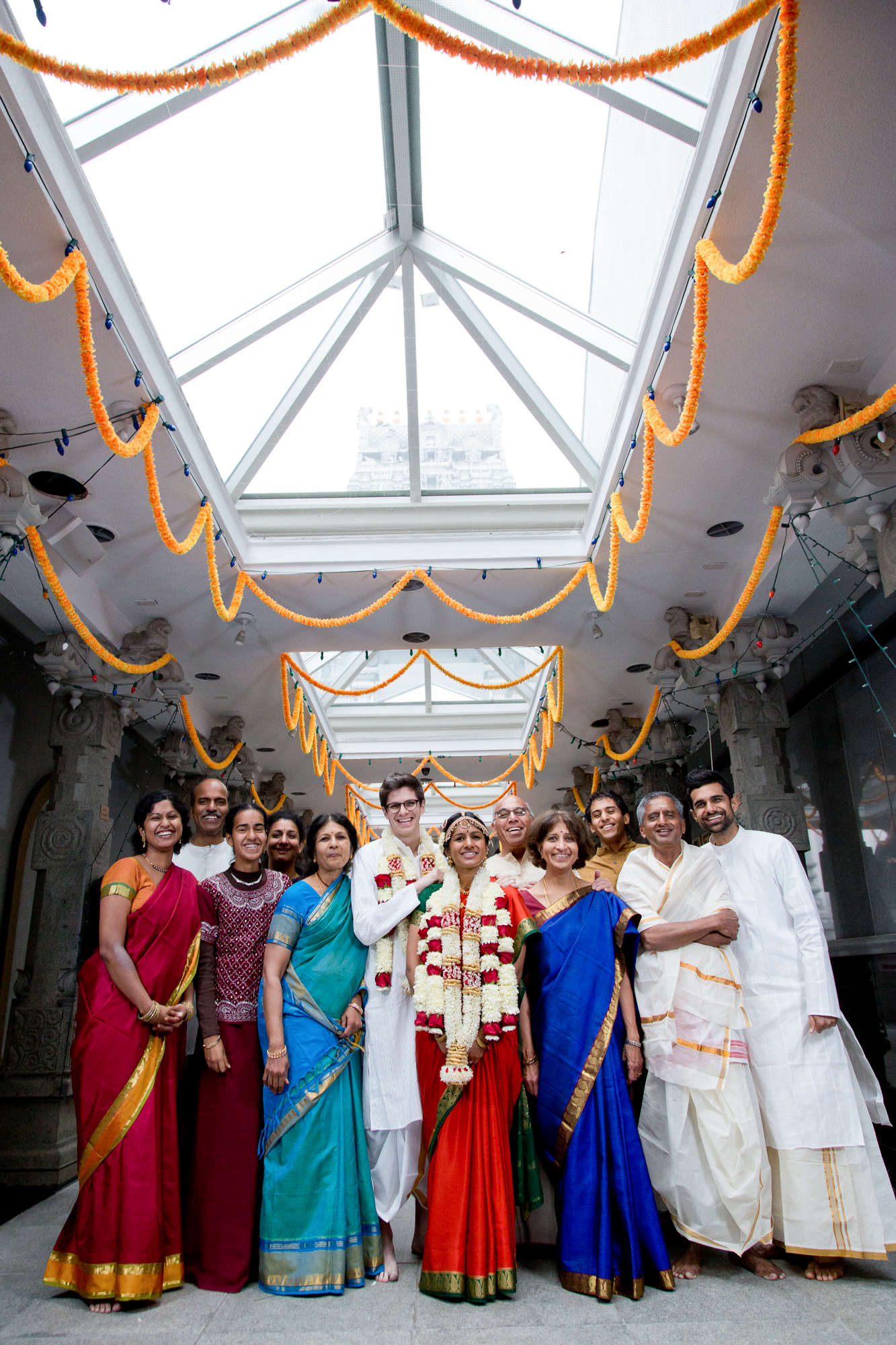 090_CarlyGaebe_SteadfastStudio_WeddingPhotography_NewYorkCity_Queens_Hindu_GaneshTemple_Indian_Bride_Groom_JasmineFlowers_WeddingParty.jpg