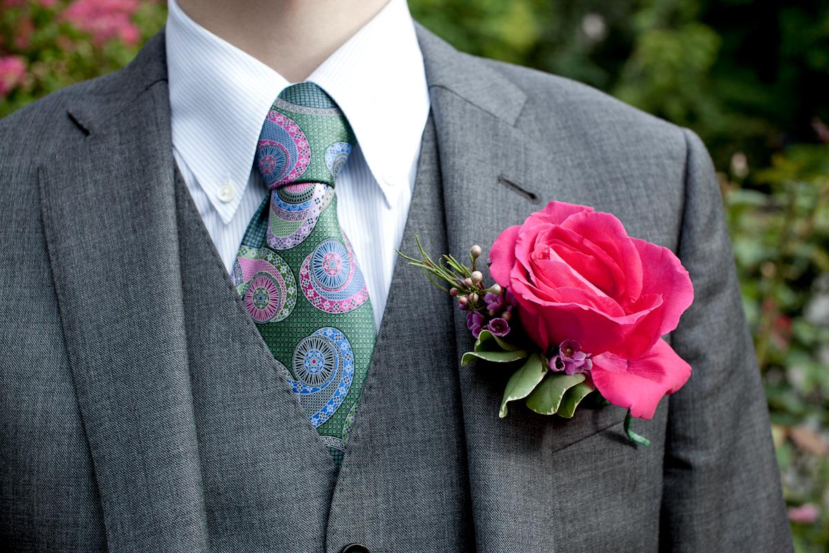 116_CarlyGaebe_SteadfastStudio_WeddingPhotography_NewYorkCity_CentralPark_ConservatoryGarden_ColorfulDress_Groom_Boutonniere_RedRose.jpg