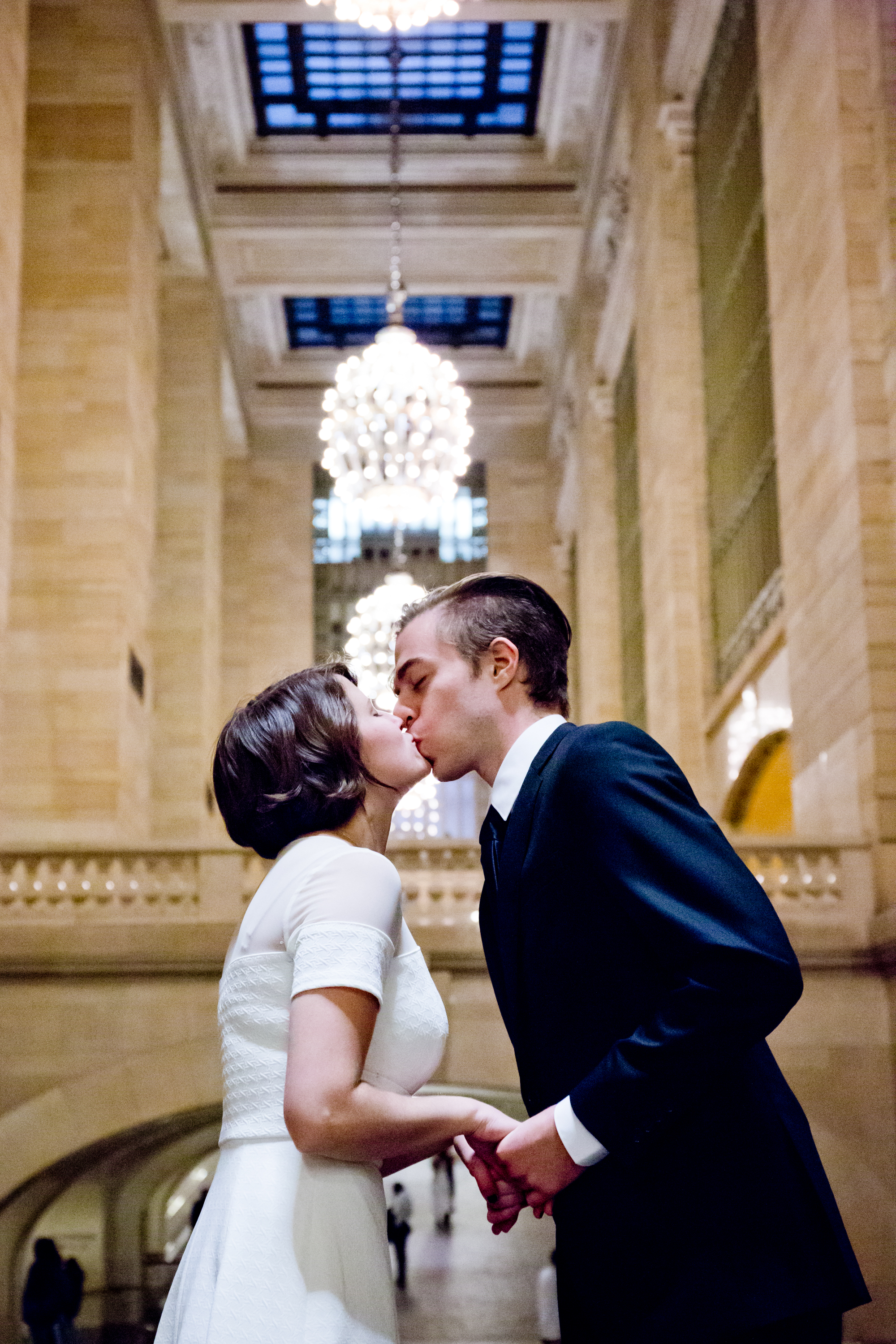 125_CarlyGaebe_SteadfastStudio_WeddingPhotography_NewYorkCity_Manhattan_GrandCentralStation_Bride_Groom_Kiss.jpg