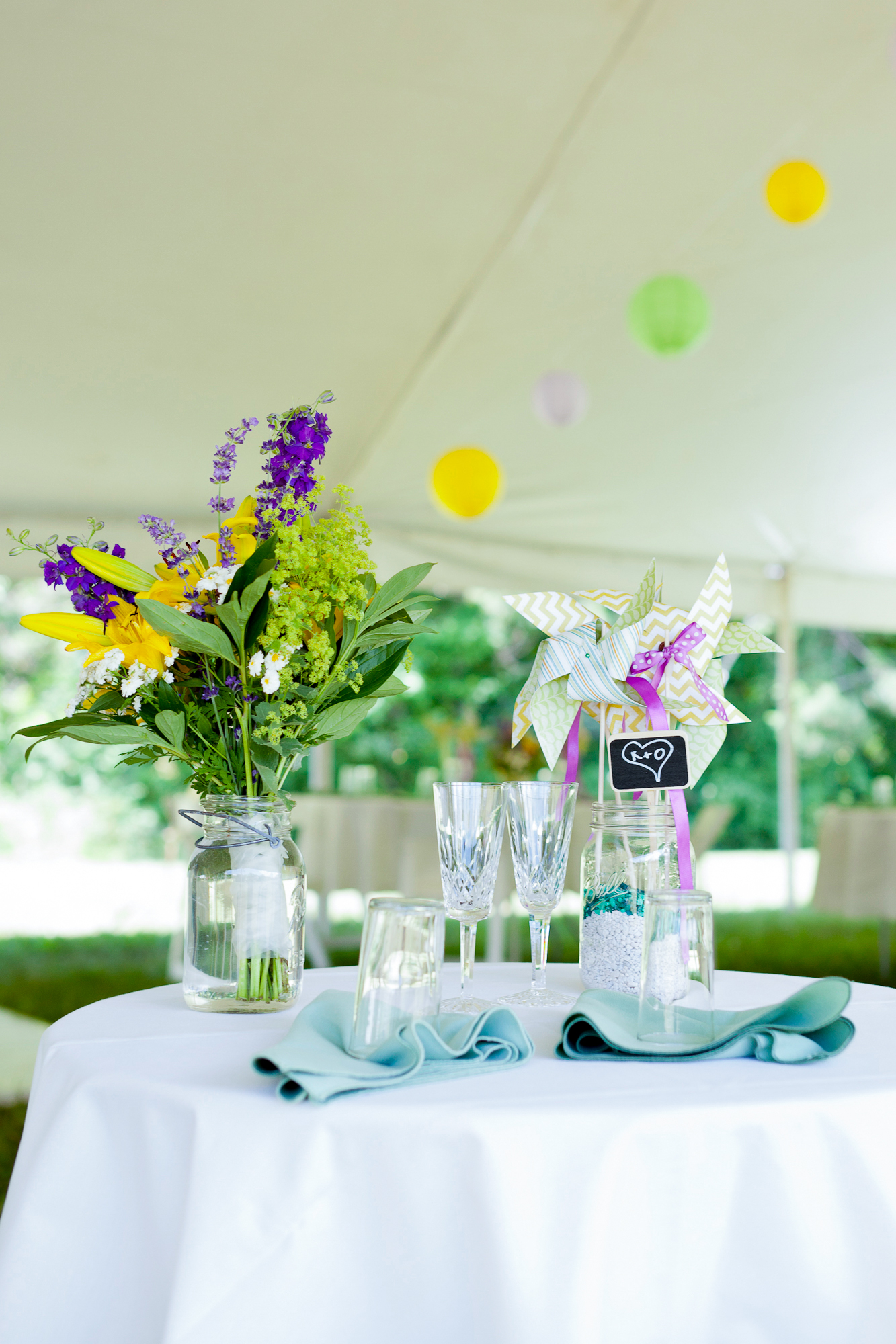 129_CarlyGaebe_SteadfastStudio_WeddingPhotography_NewYork_Ithaca_Winery_SixMileCreekVineyard_TableDecor_Colorful_FlowerArrangement.jpg