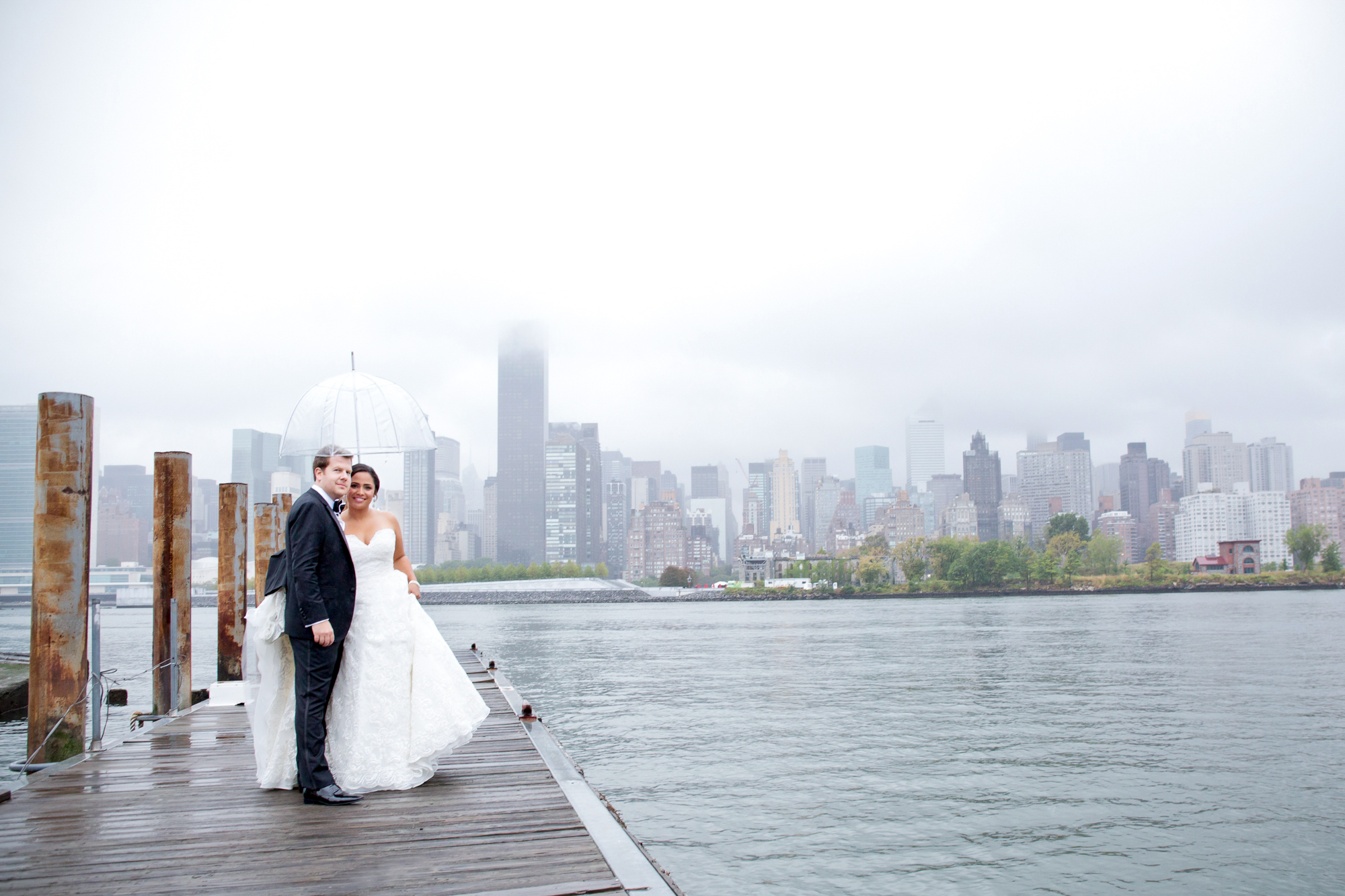 142_CarlyGaebe_SteadfastStudio_WeddingPhotography_NewYork_LongIslandCity_WatersEdge_EastRiver_Rainy_Umbrella_Bride_Groom.jpg